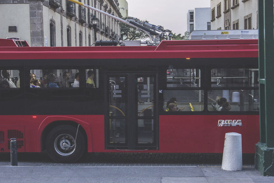The red bus. Architecture Built Structure Bus Cable Car City City Life City Street Day Mode Of Transport No People Outdoors Public Transportation Red Red Bus Stationary Street Street Photography Transportation Travel Destinations Urban Lifestyle Urban Scene Urban Transportation
