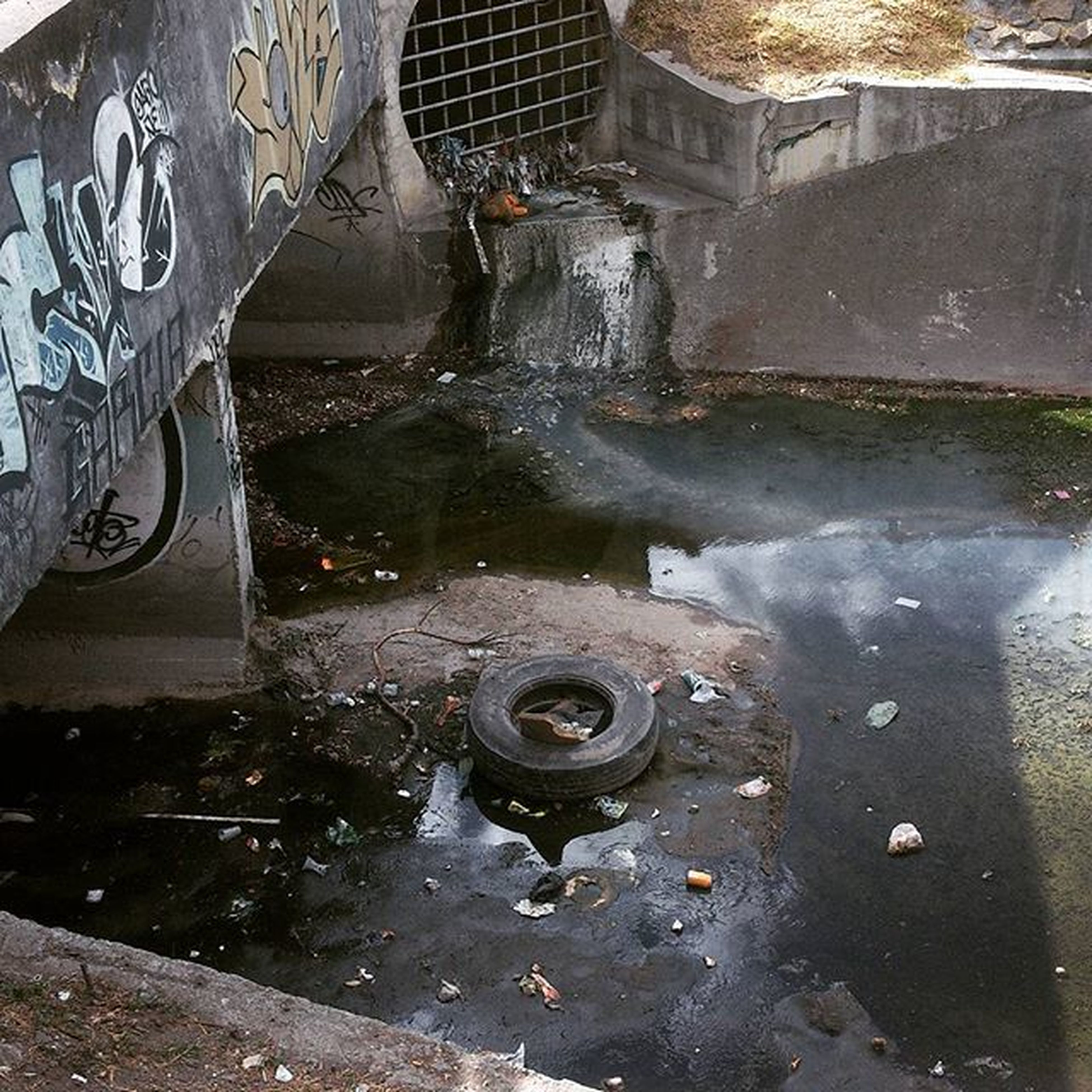 water, high angle view, abandoned, damaged, obsolete, puddle, reflection, built structure, messy, deterioration, wet, run-down, metal, architecture, day, outdoors, no people, old, dirty, transportation
