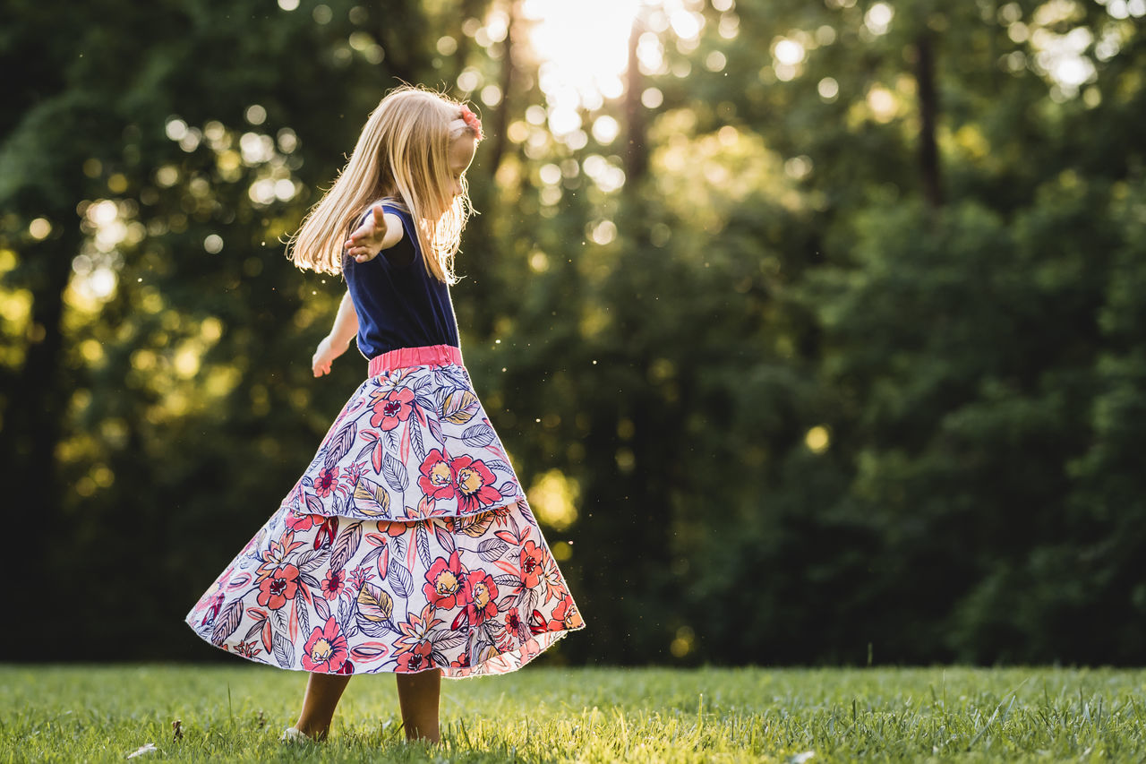 Blond Hair Childhood Day Dress Girl Girls Grass Happiness Kids Nature One Person Outdoors People Play Real People Smiling