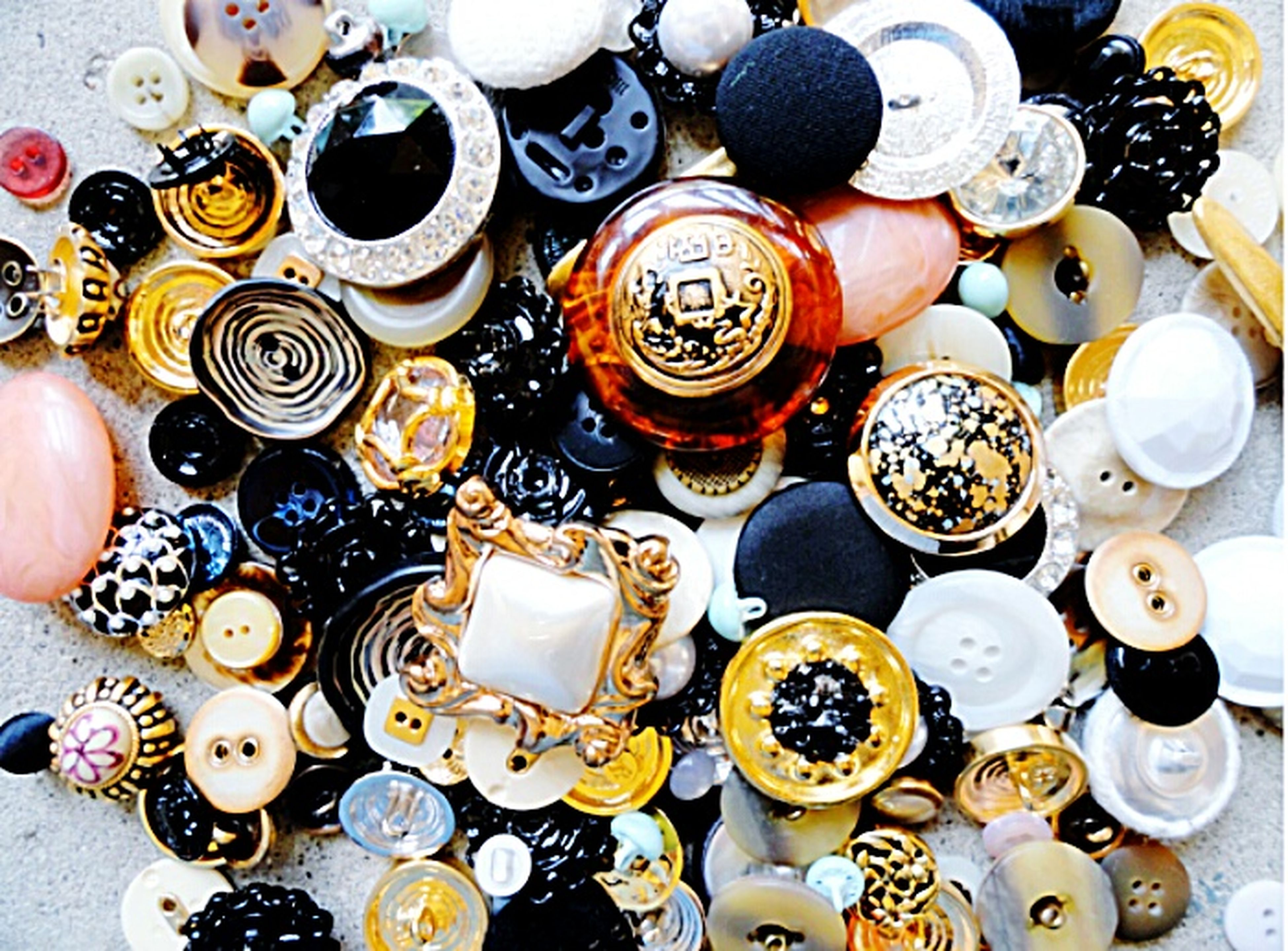 large group of objects, indoors, variation, abundance, choice, high angle view, arrangement, still life, collection, multi colored, food and drink, directly above, bottle, order, coin, container, in a row, full frame, table, button
