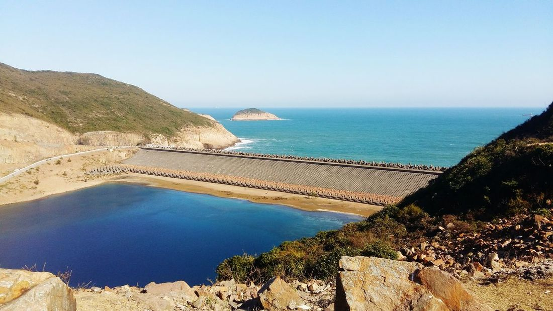 Hong Kong High Island Reservoir Sunny Day Gradient Mountain Beach Horizon Over Water Scenics Tranquility Beauty In Nature Sky Blue Clear Sky