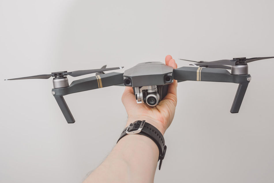 Holding drone in hand Adult Adults Only Bird Camera Day Drone  Holding Holding Drone Human Body Part Human Hand Modern New Technology One Person People Quadcopter Small Studio Shot Technology Uav Video White Background Mavic Mavic Pro DJI Mavic Pro