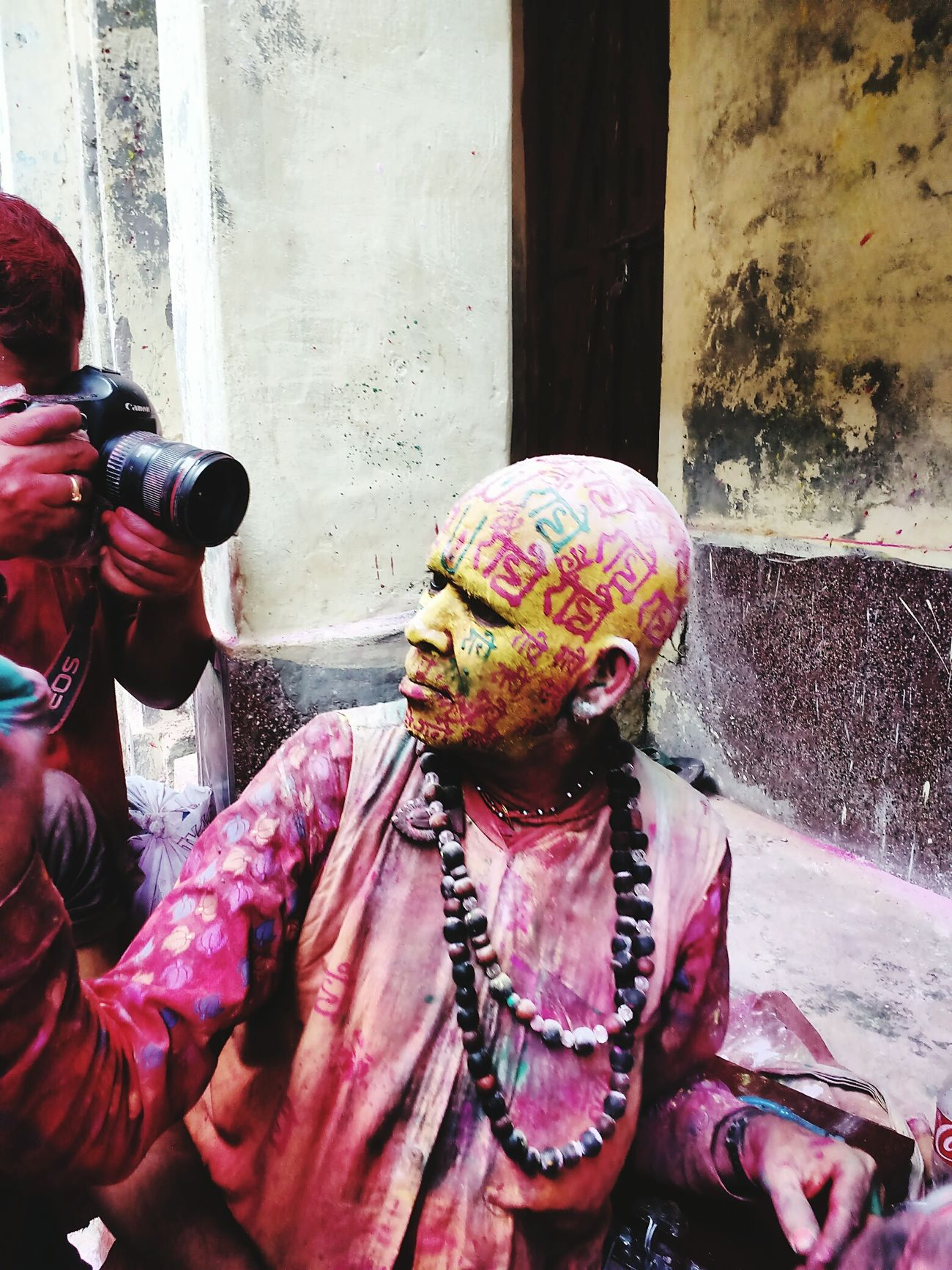 Festival of color Holi Festival lathmaar holi Barsanaholi baba writing radhe radhe on people faces Uniqueness