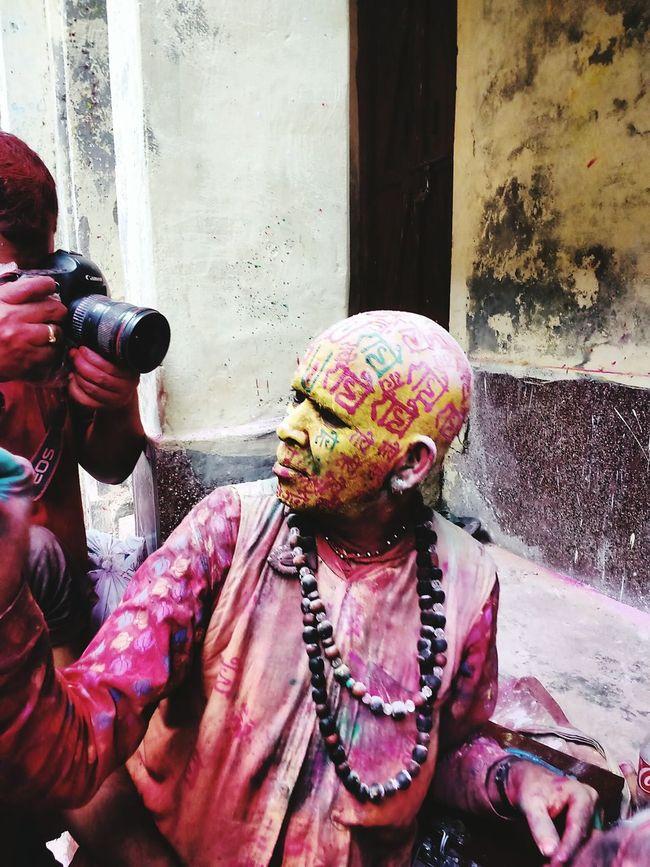 Festival of color Holi Festival lathmaar holi Barsanaholi baba writing radhe radhe on people faces