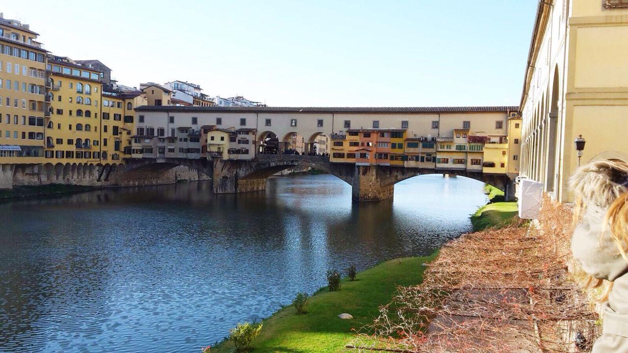 Ponte Vecchio Over River Arno Against Sky