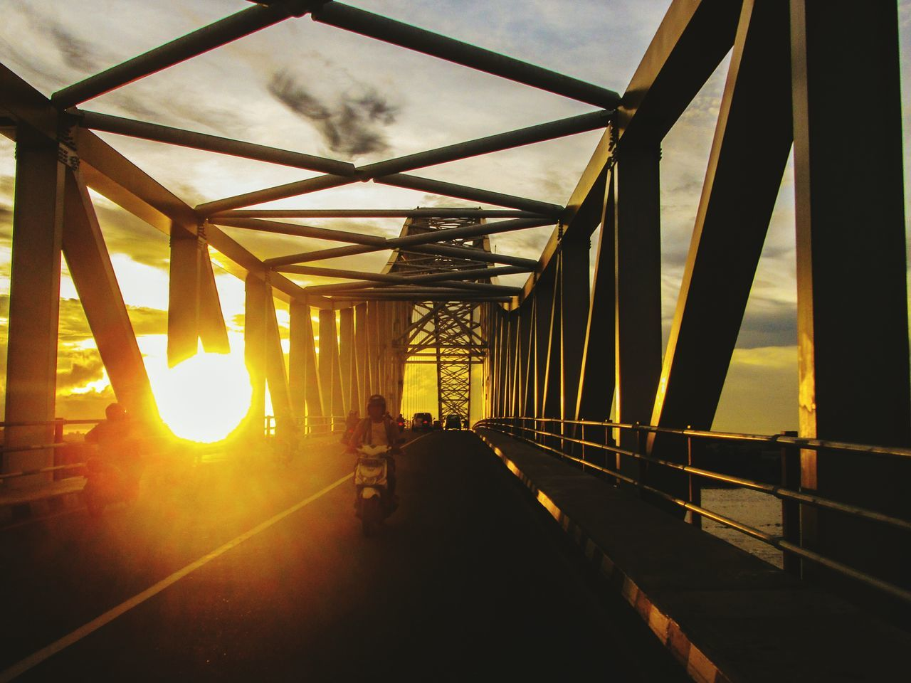 bridge - man made structure, connection, engineering, sunset, transportation, suspension bridge, sky, sun, built structure, sunlight, architecture, travel, bridge, silhouette, outdoors, no people, day, city