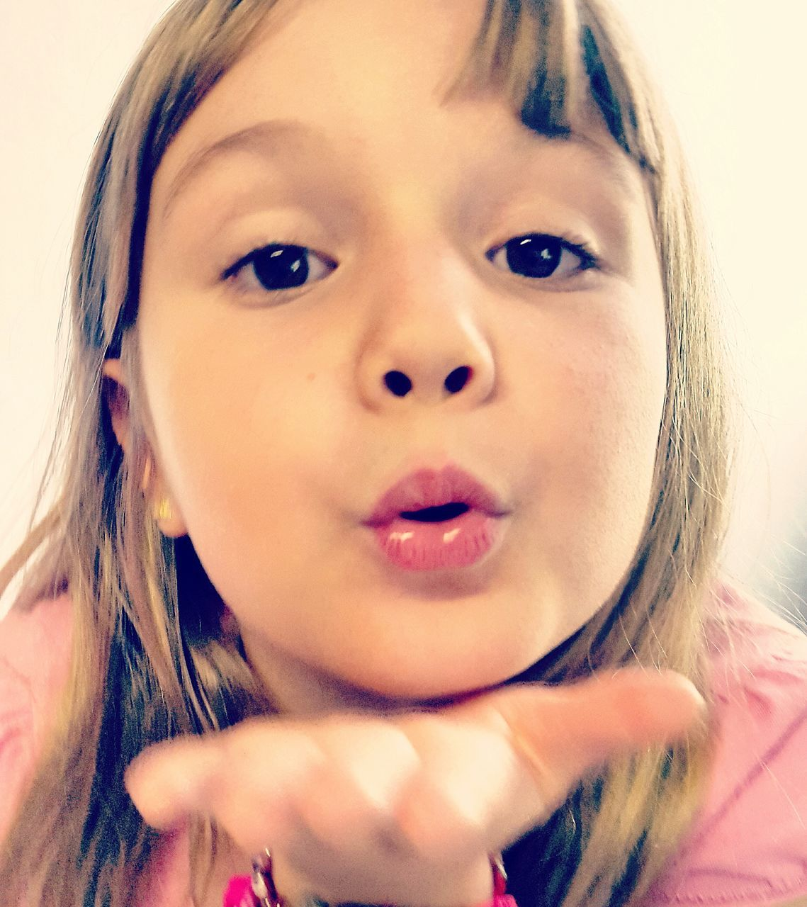 Close-Up Portrait Of Girl Blowing A Kiss