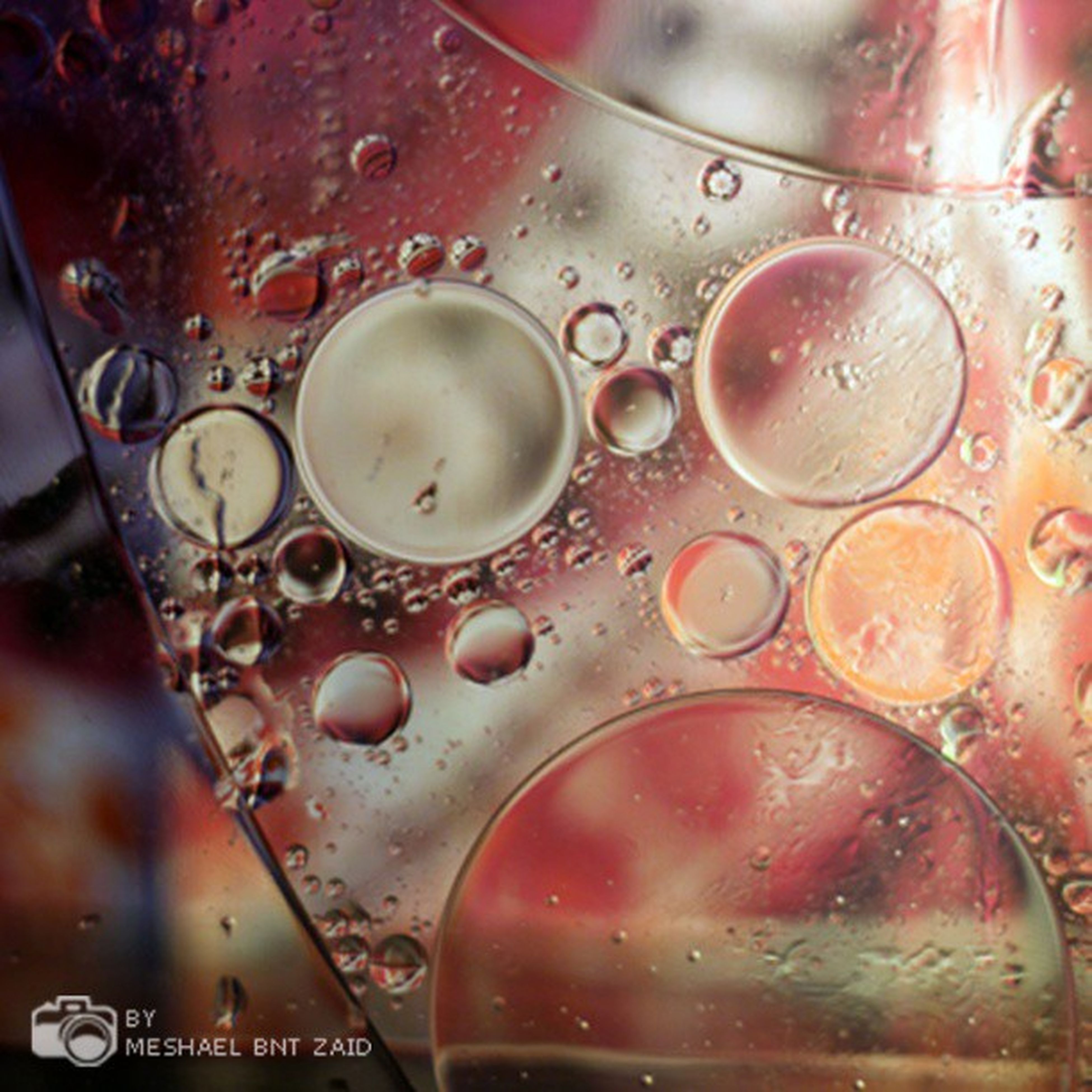 indoors, close-up, food and drink, still life, glass - material, high angle view, part of, metal, no people, freshness, technology, table, drink, focus on foreground, wet, circle, reflection, red, transparent, communication