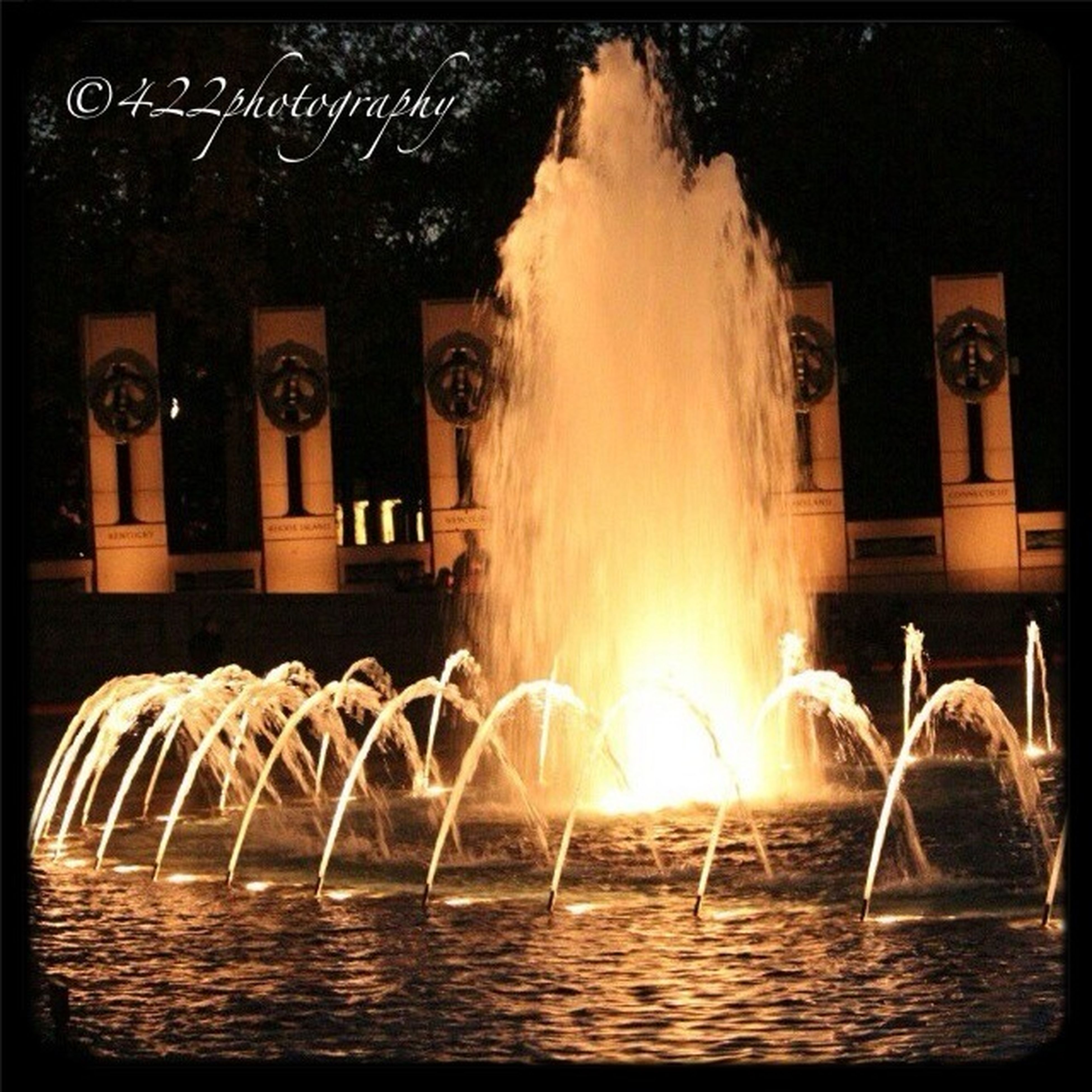 fountain, fire - natural phenomenon, motion, flame, night, burning, long exposure, illuminated, auto post production filter, transfer print, water, heat - temperature, built structure, building exterior, no people, architecture, glowing, close-up, outdoors, reflection