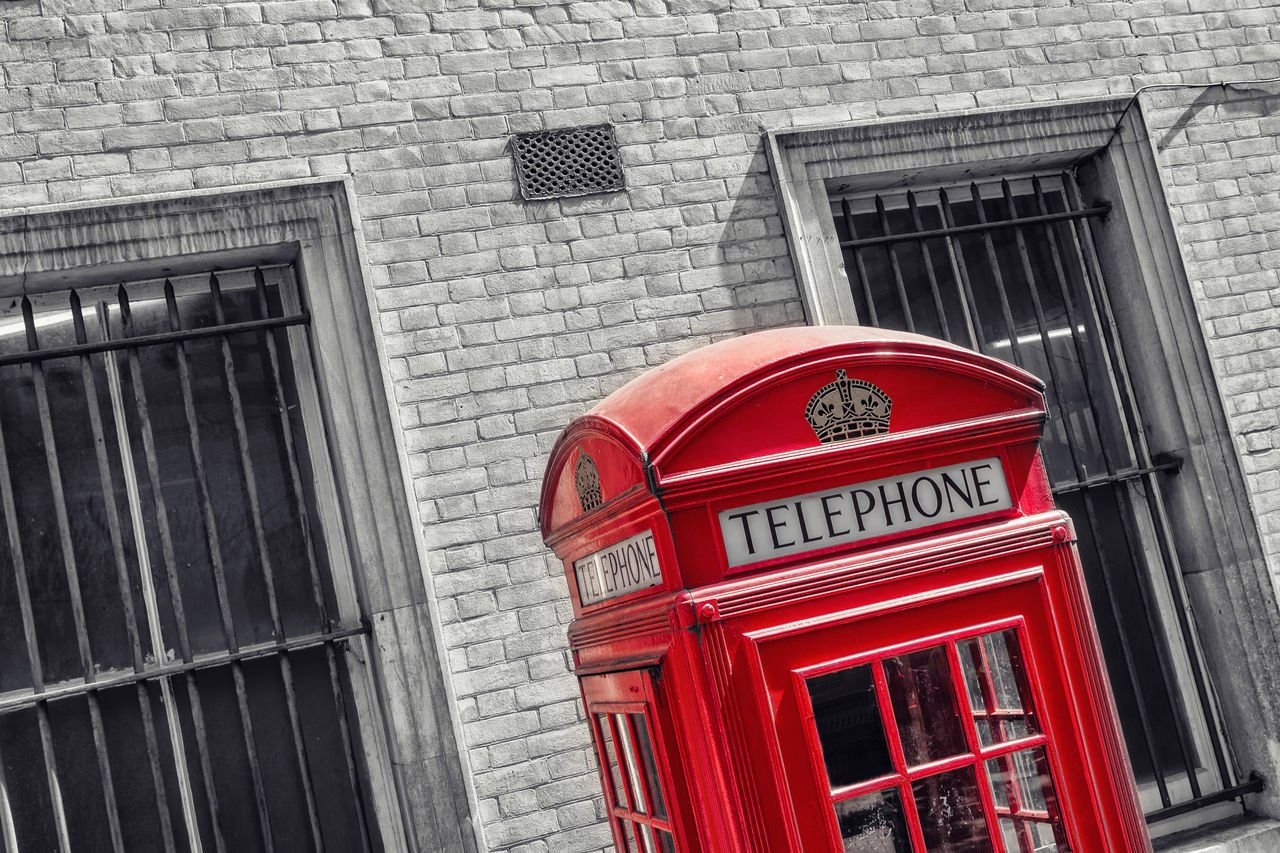 red, communication, telephone booth, building exterior, built structure, architecture, pay phone, no people, day, telephone, outdoors, convenience, technology, city, close-up