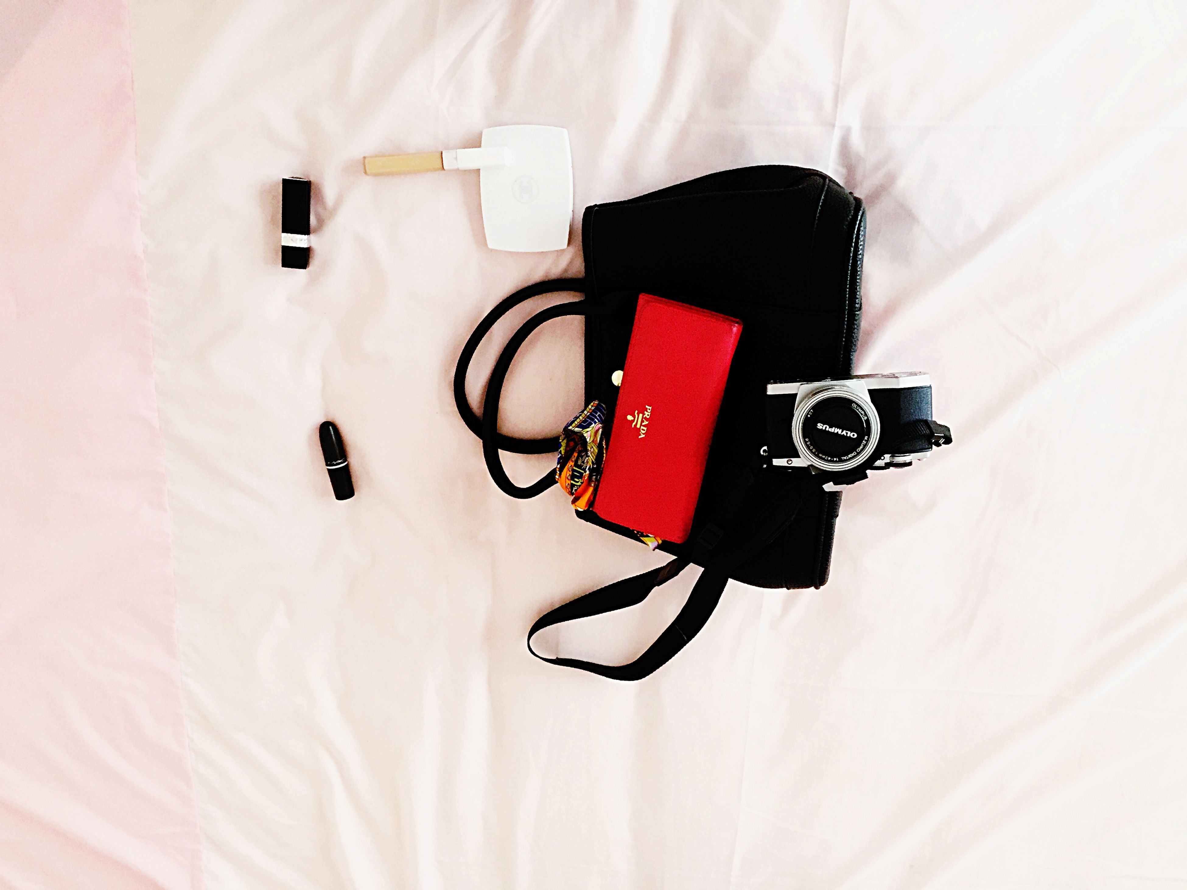 indoors, still life, technology, close-up, high angle view, white background, connection, single object, toy, white color, studio shot, man made object, hanging, red, no people, equipment, wall - building feature, clothing, fashion, table