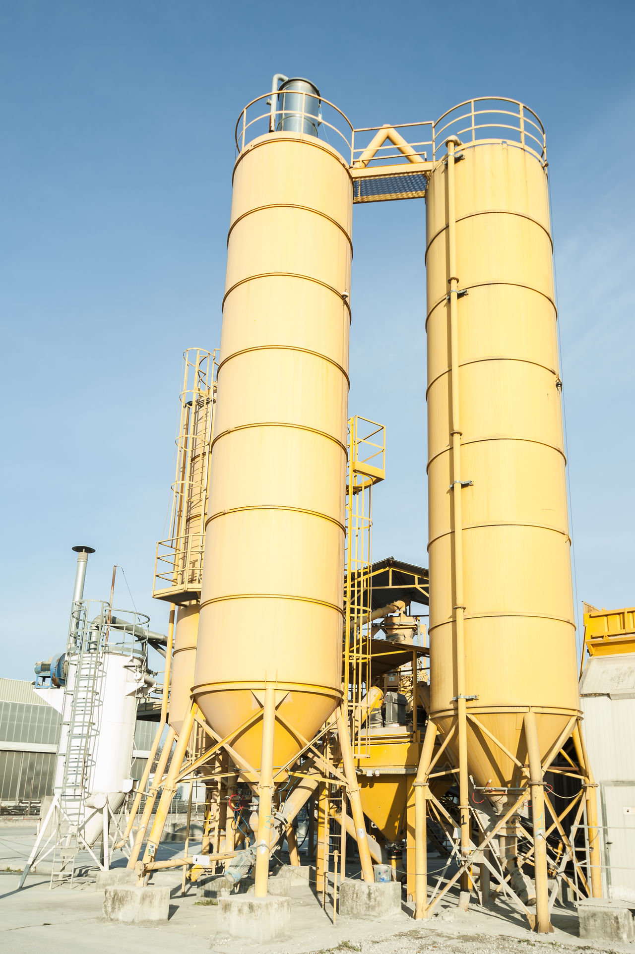 Industrial silos for the production of concrete Agriculture Built Structure Business Finance And Industry Construction Day Factory Industry Industry No People Outdoors Petrochemical Plant Silo Sky Storage Tank Warehouse