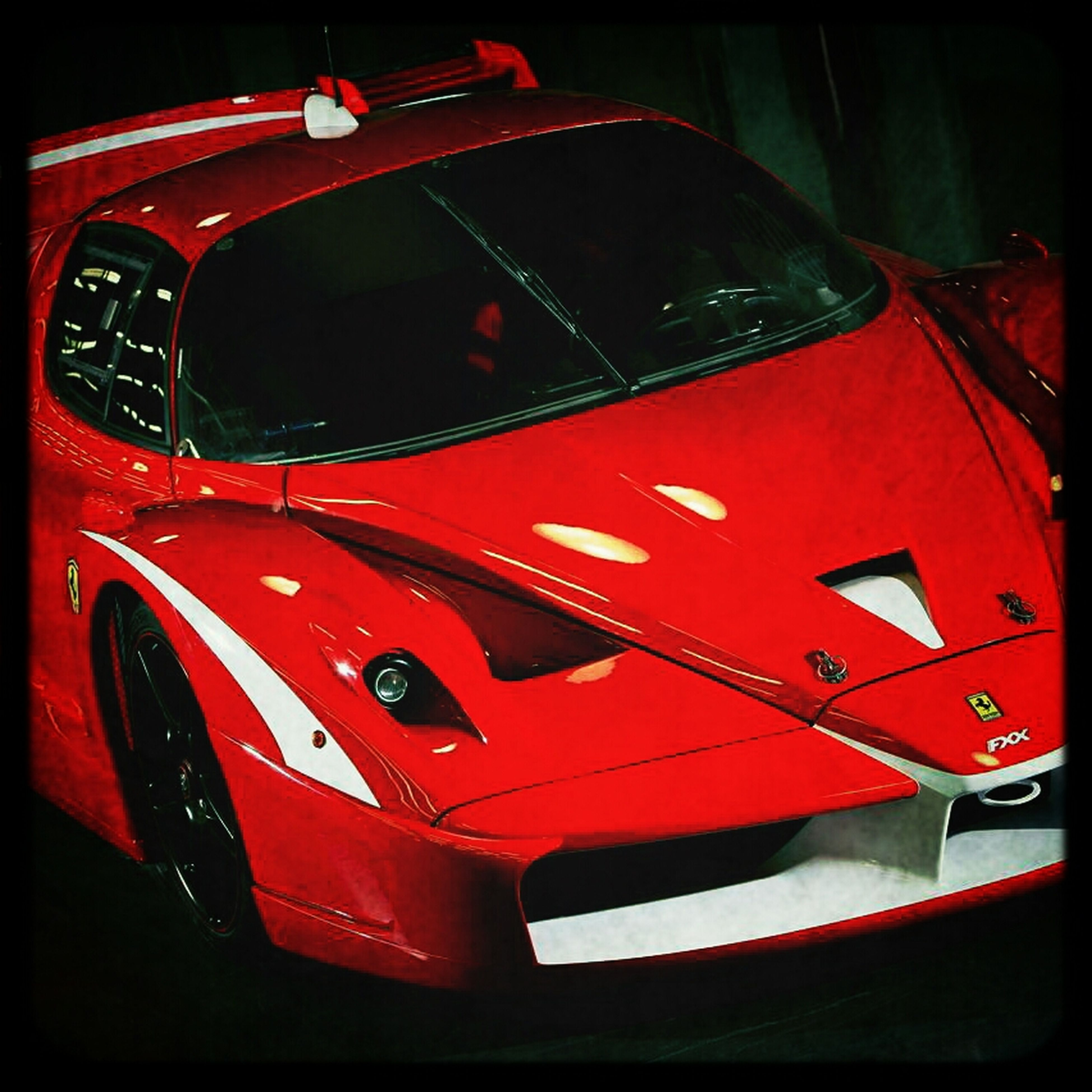 red, transportation, car, mode of transport, land vehicle, close-up, indoors, part of, no people, high angle view, vehicle interior, travel, auto post production filter, day, black color, cropped, detail, still life