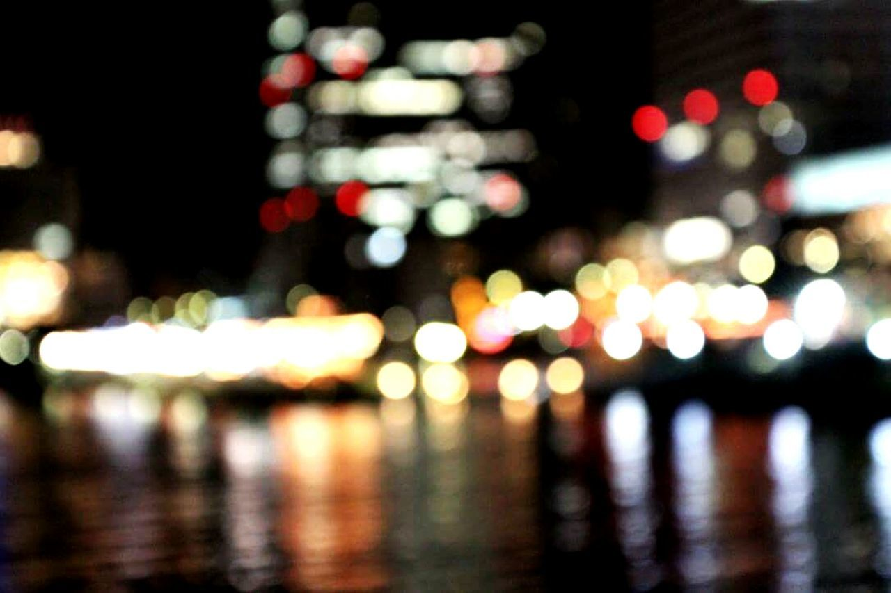 illuminated, night, reflection, outdoors, focus on foreground, defocused, no people, water, city, close-up
