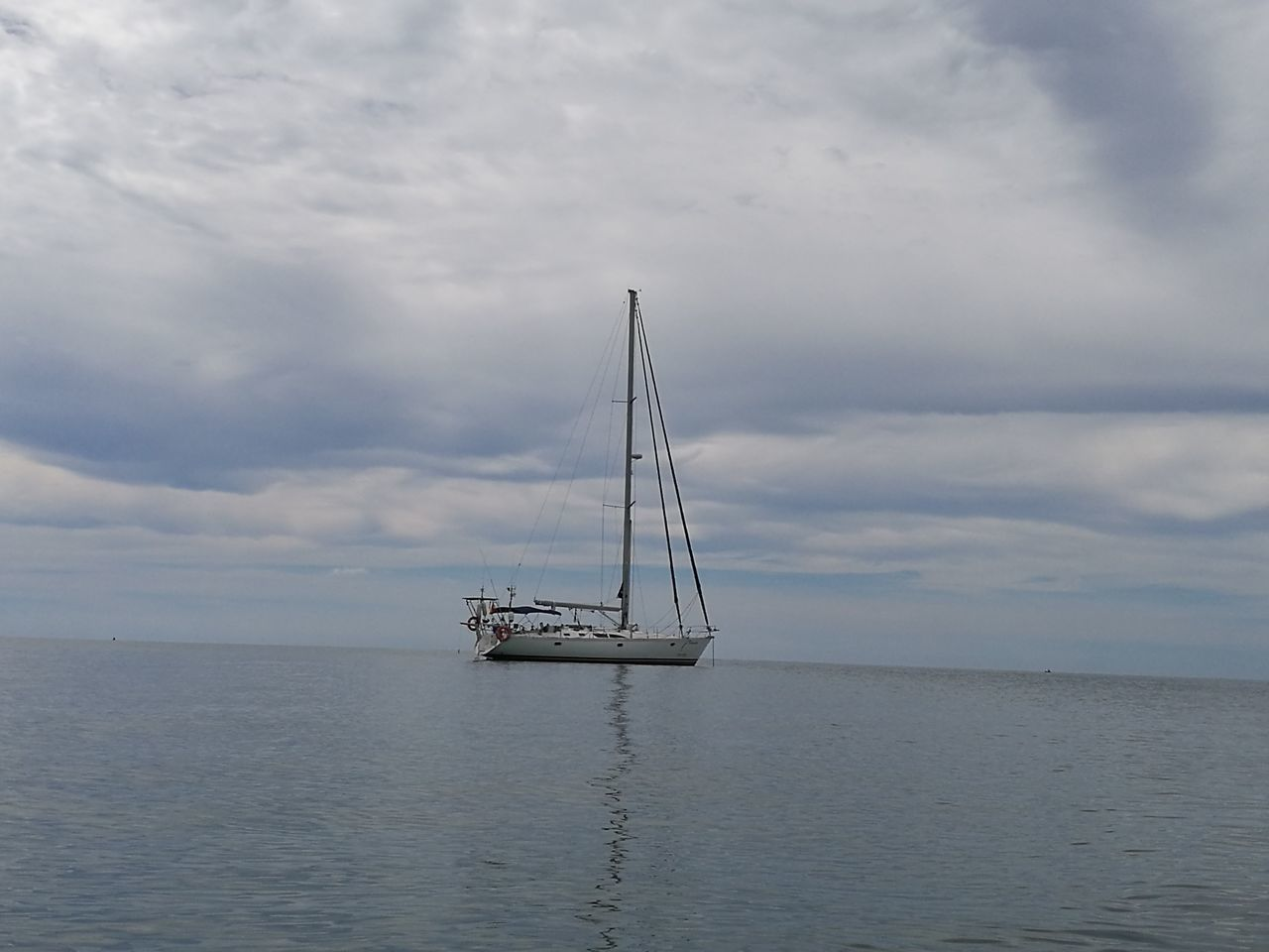 water, sky, nautical vessel, cloud - sky, sea, transportation, mode of transport, waterfront, nature, beauty in nature, no people, tranquility, mast, outdoors, day, scenics, moored, sailboat, horizon over water, sailing