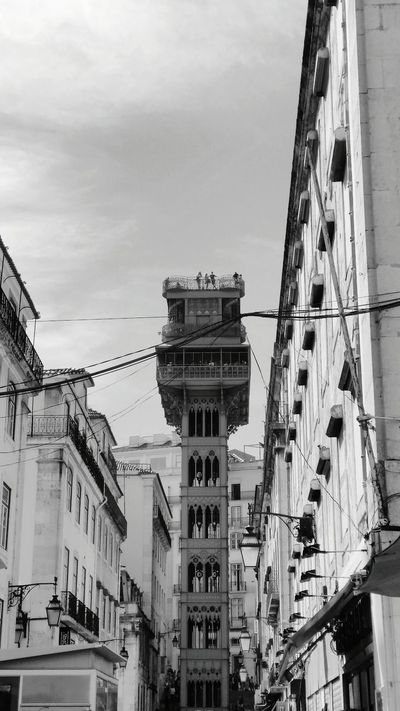 Architecture Building Exterior Built Structure Low Angle View City Residential Structure Residential Building Tower Sky Tall - High Travel Destinations City Life Old Town Outdoors Day History Blue Building Story Residential District Cloud - Sky Lisbon Lisboa Portugal Elevador De Santa Justa MonochromePhotography