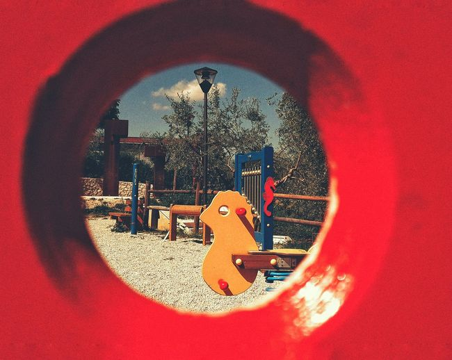 Playground Red Day No People Close-up Yellow Horse Hole Game Park Enjoyment Sky Tree Area Architecture Musical Instrument Arts Culture And Entertainment