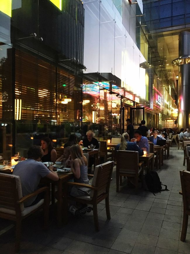 Packed Full House People Family Time Evening Illuminated Sitting Chair Table Lifestyles City Leisure Activity Food And Drink Dining Side View Architecture Building Exterior Built Structure Outdoor Restaurant City Life Sidewalk Cafe Group Of People The Week On EyeEm EyeEm Market ©