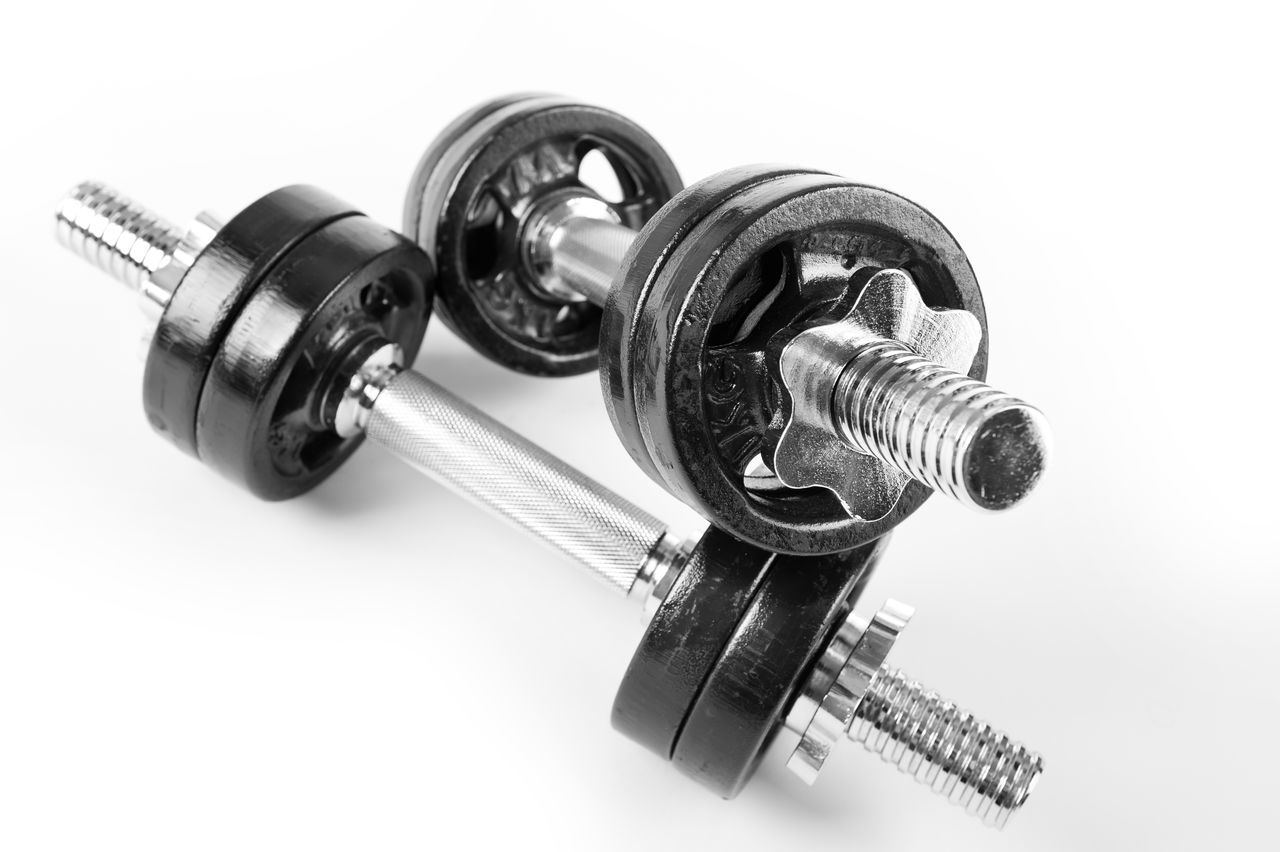 Chrome bolt on hand barbells weights black color on white background in horizontal orientation, nobody. Barbell Barbells Bolts Dumbbell Dumbbells Excercise Fitness Gym Heavy Metal No People Sport Still Life Weight Weights White Background
