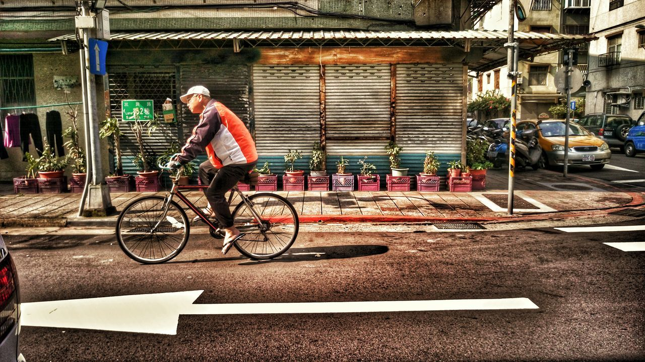 Bicycle Outdoors One Person People Headwear Men Light And Shadow Street Photography Oldtown Life Taking Photos Nightphotography Enjoying The Sun Enjoying Life Potted Plant
