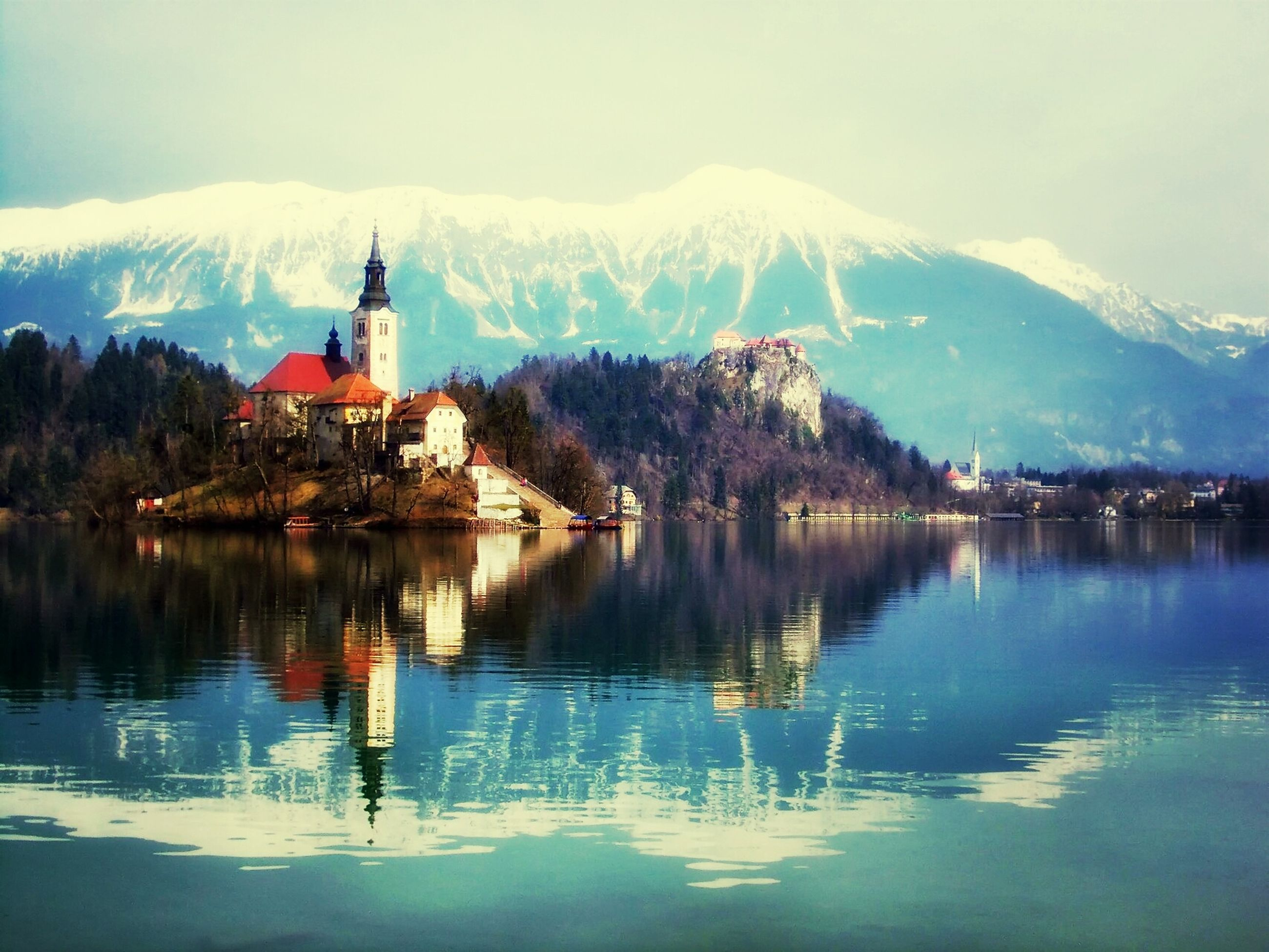 mountain, building exterior, architecture, built structure, mountain range, water, lake, reflection, winter, snow, cold temperature, waterfront, house, scenics, tranquil scene, season, tranquility, beauty in nature, nature, sky