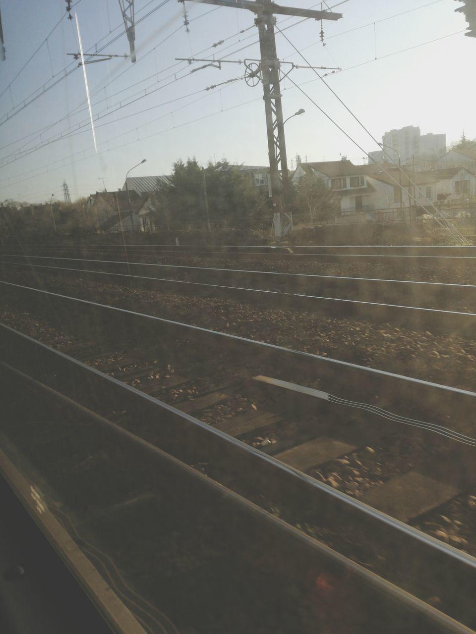 railroad track, cable, rail transportation, transportation, power line, electricity, power supply, electricity pylon, connection, no people, public transportation, day, sky, outdoors, clear sky, nature