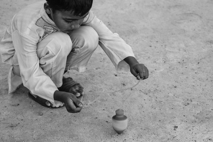 Childhood Child Day Outdoors Full Length Playing Play Playground Gasing Gangsing Children Only Real People Monochrome Blackandwhite Traditional Documentary Black And White Friday Boy Kid