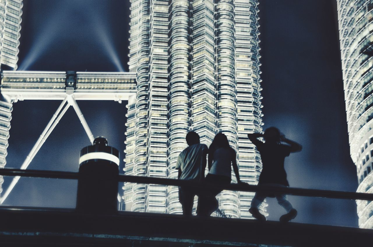 Silhouette Silhouettes Petronas Twin Towers Kuala Lumpur Kuala Lumpur Malaysia  Malaysia Built Structure Architecture Building Exterior Lifestyles Leisure Activity Low Angle View City Outdoors Skyscraper Sky Nightphotography Pentax K20d Travel Photography One Of My Best Pictures  A Night At The Park Youngsters From My Point Of View Reedited Enjoy The New Normal