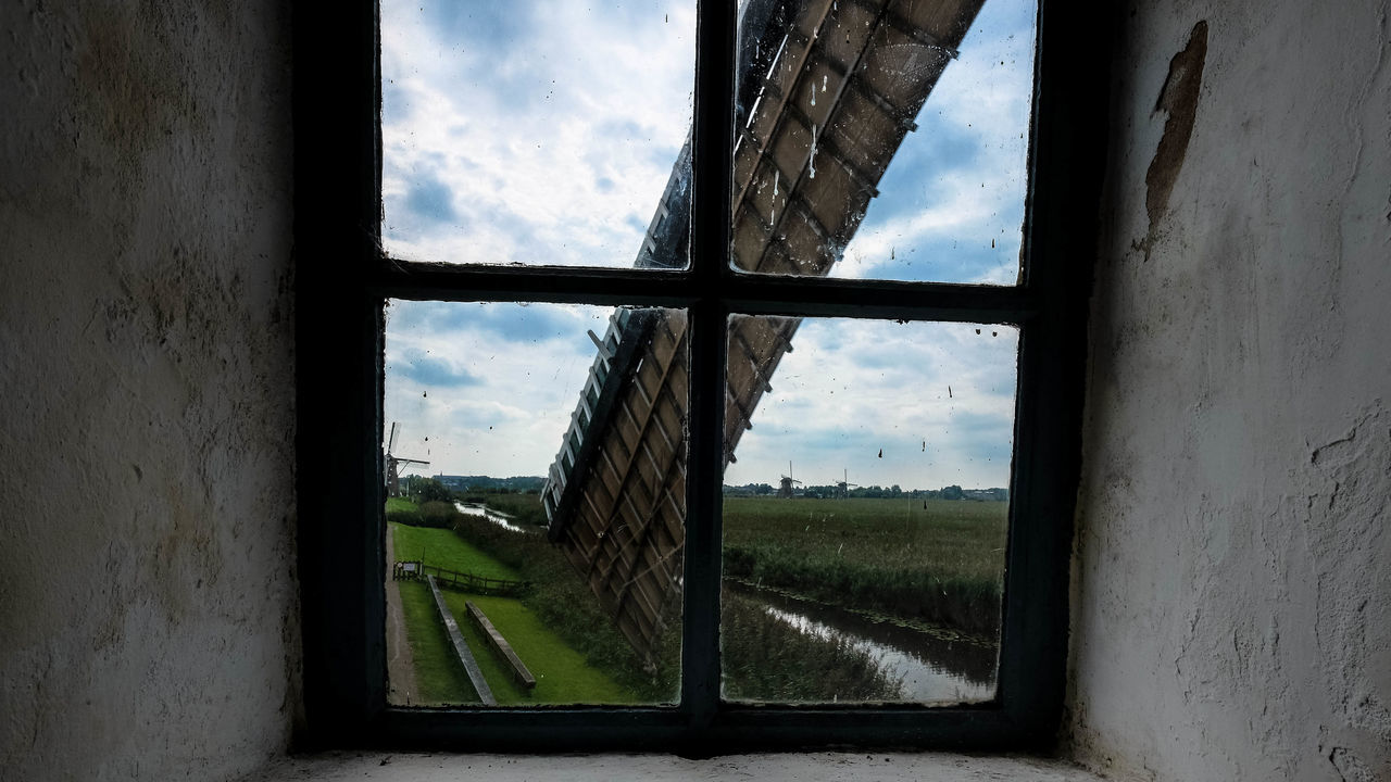 window, sky, cloud - sky, day, landscape, field, no people, indoors, nature, built structure, architecture, scenics