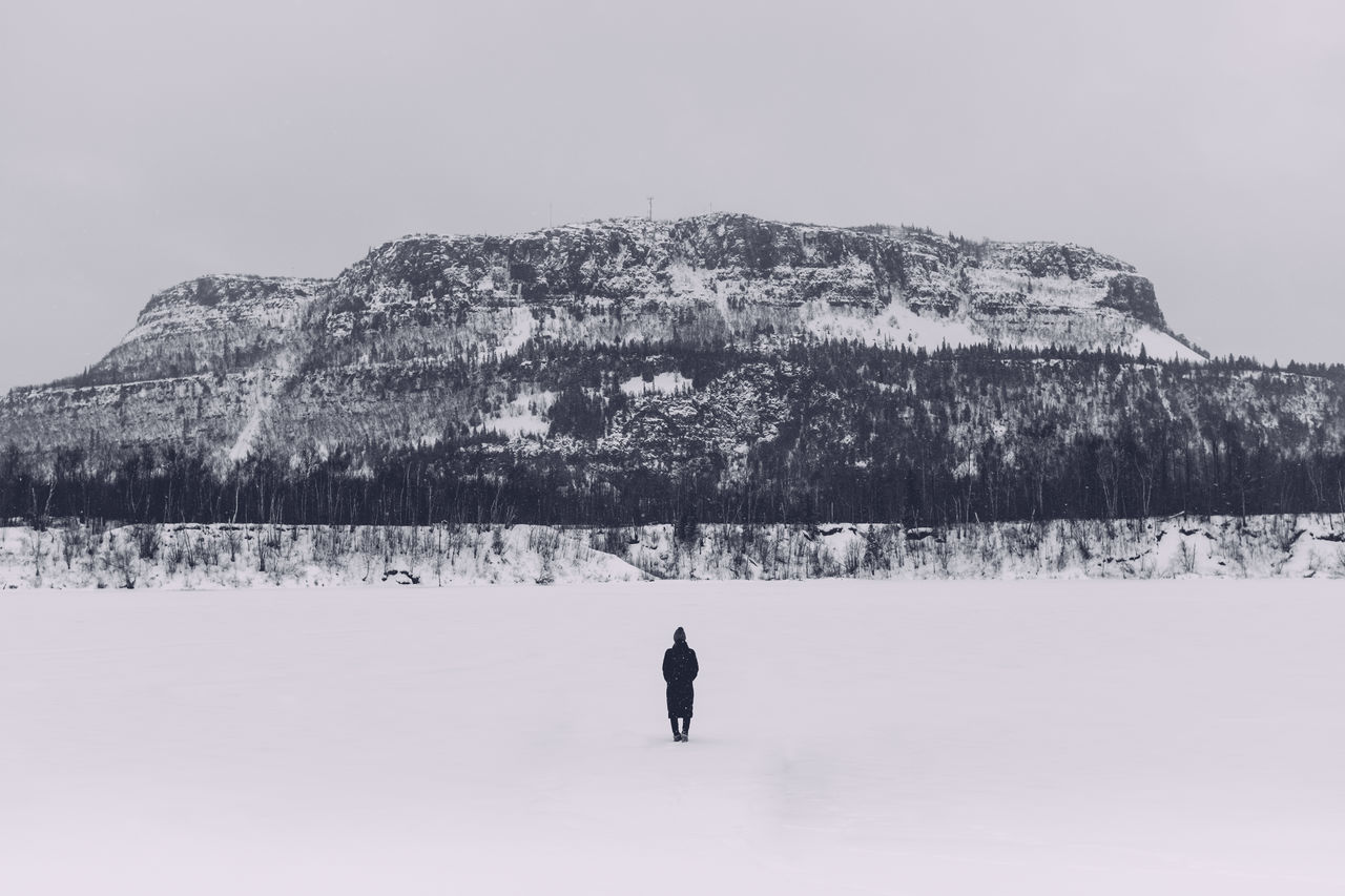 Winter Woman Mountain Frozen Lake Winter Scene Dark Figure Centered Composition Mount McKay Finding New Frontiers