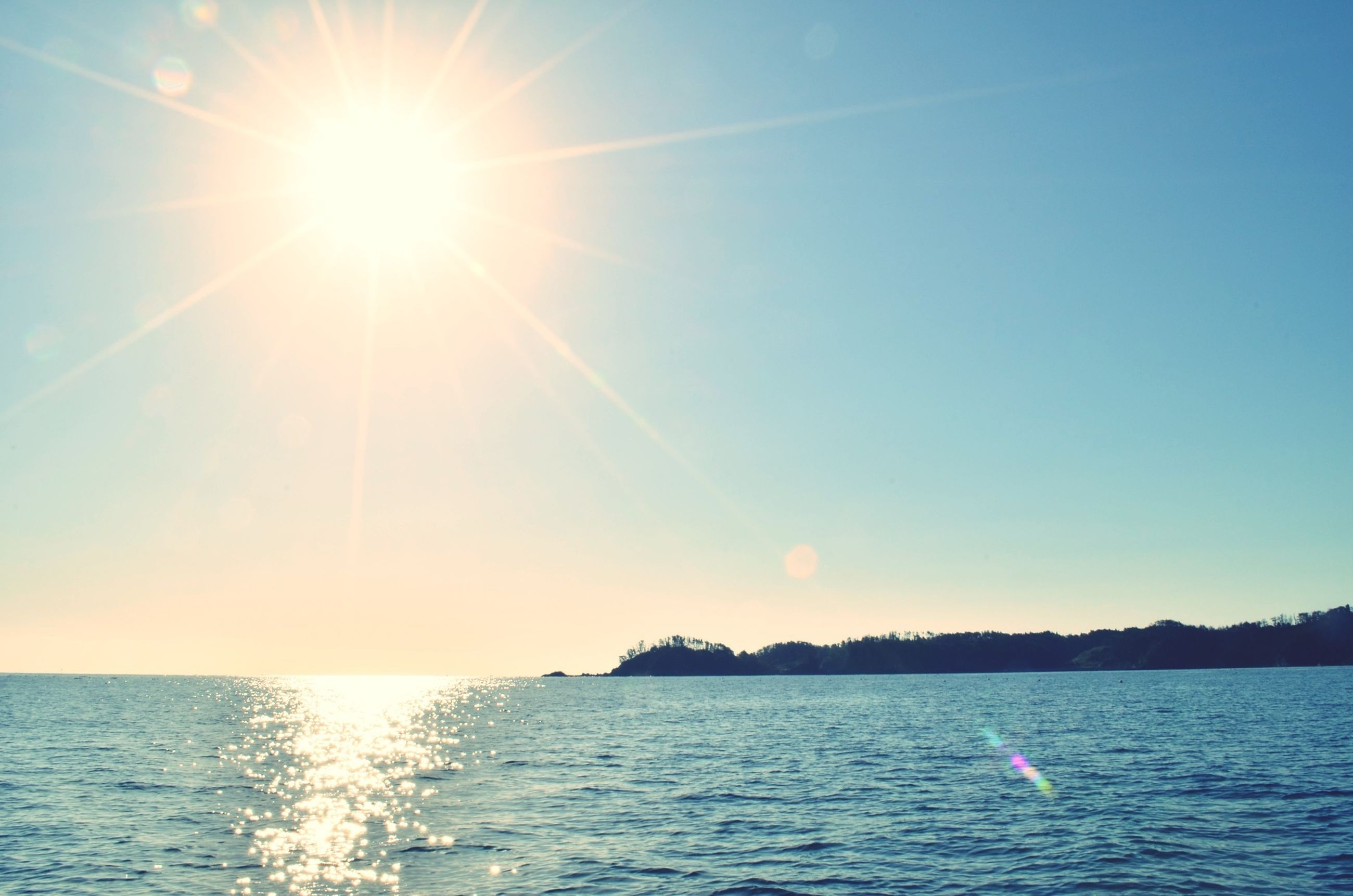 sun, water, sea, waterfront, sunlight, scenics, sunbeam, tranquil scene, horizon over water, tranquility, lens flare, beauty in nature, sky, nature, clear sky, rippled, idyllic, blue, bright, sunny