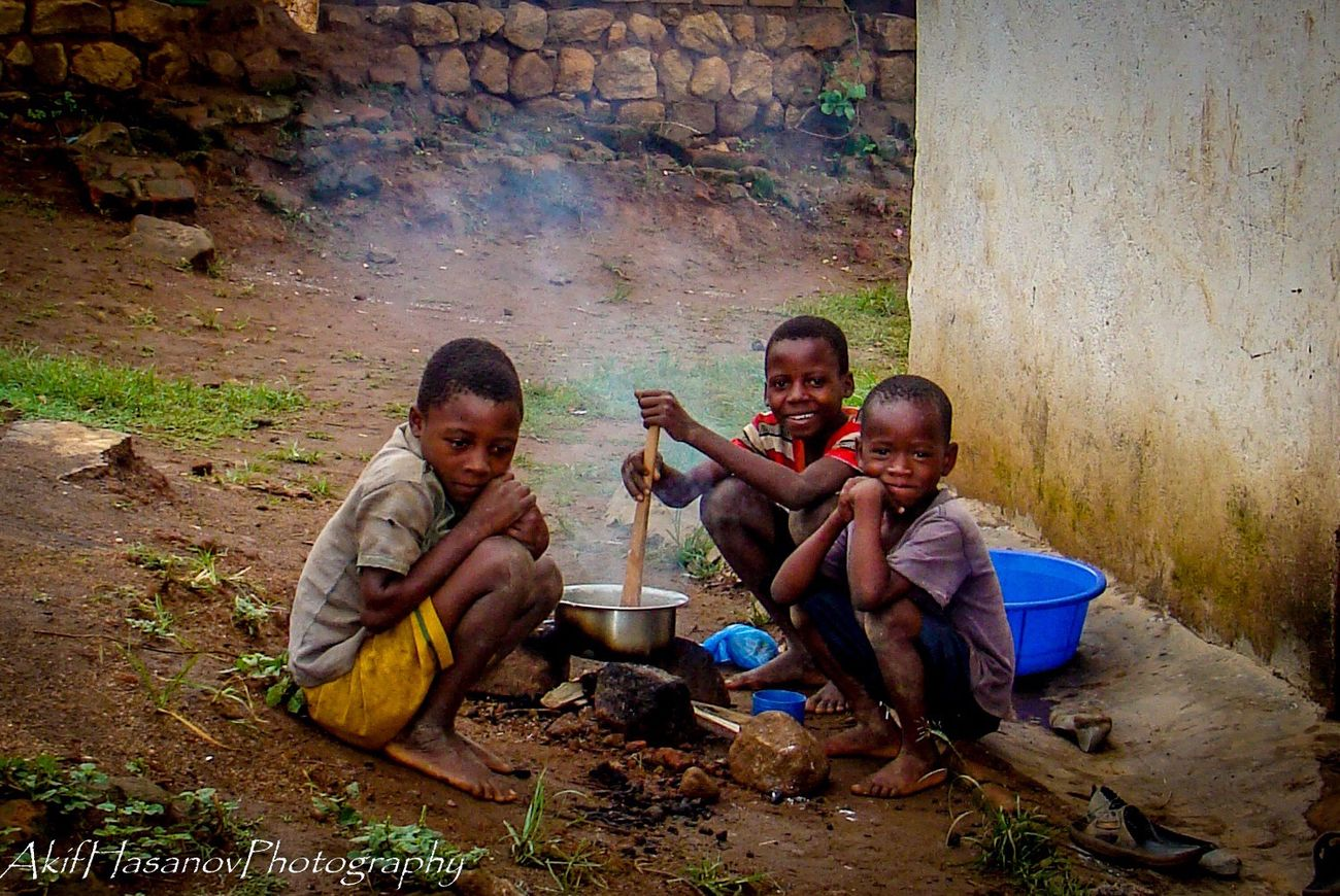 ShareTheMeal cooking nsima for breakfast Boys Smiling Sitting Togetherness Happiness Family Eating Food Sharing Visual Feast