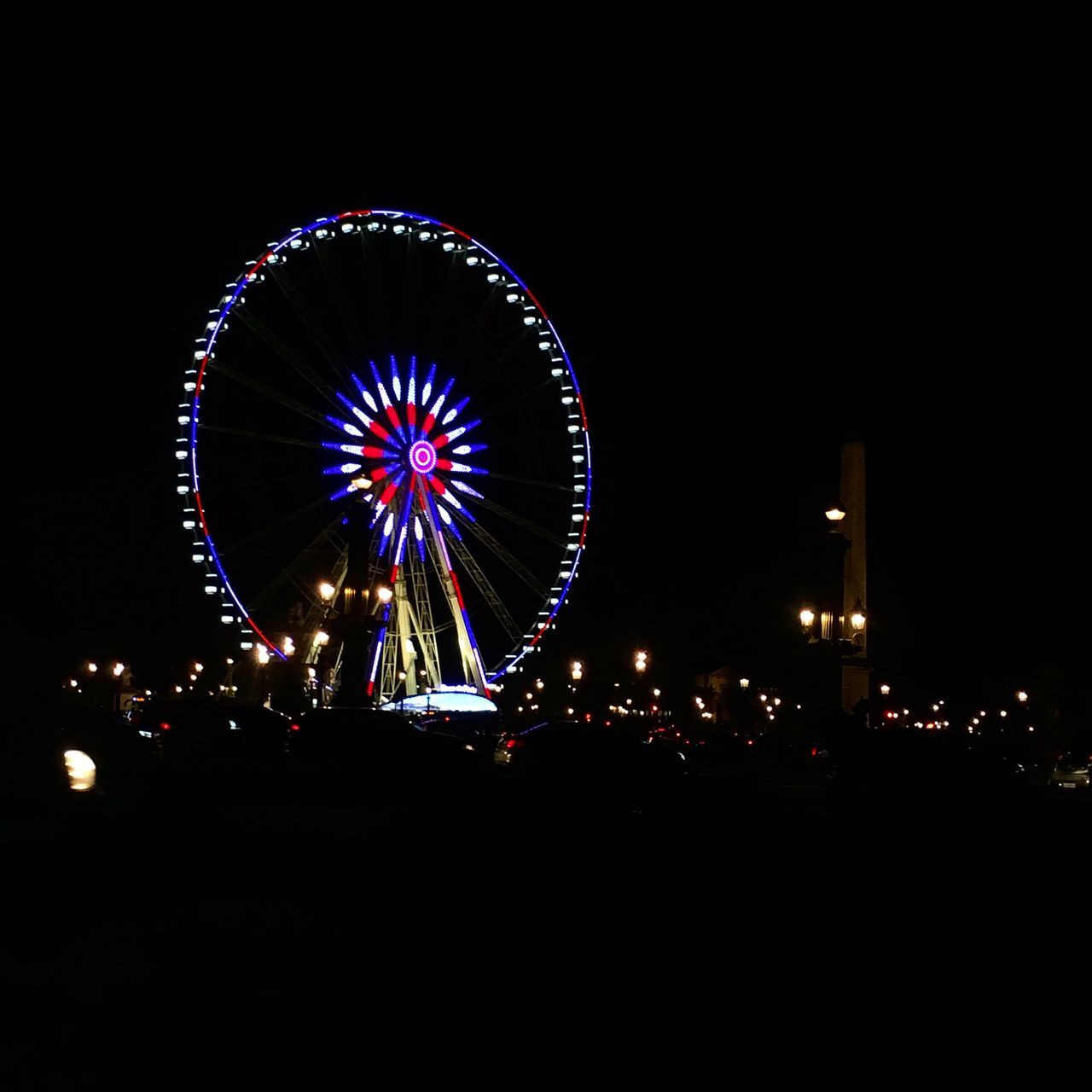 arts culture and entertainment, night, illuminated, amusement park, leisure activity, amusement park ride, outdoors, low angle view, ferris wheel, sky, large group of people, clear sky, people