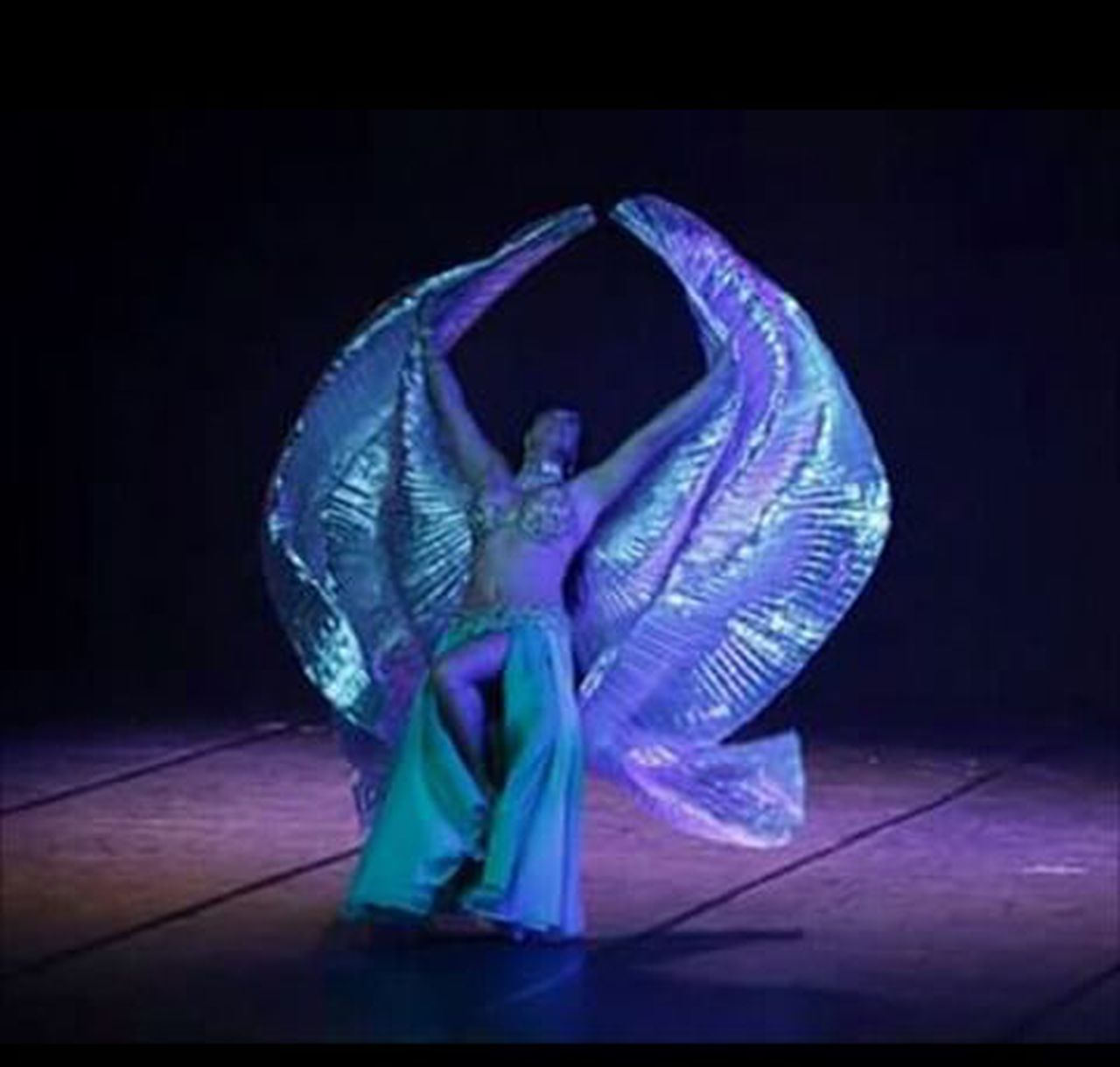 dancing, illuminated, one person, one woman only, full length, only women, adults only, blue, people, adult, performance, night, one young woman only, indoors, young adult