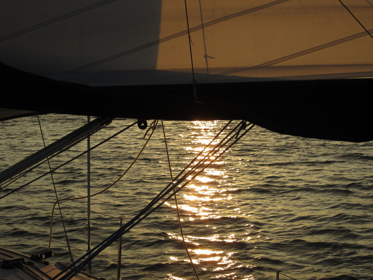 sea, water, nautical vessel, sailing, sunset, nature, transportation, sailboat, mode of transport, outdoors, no people, waterfront, sky, sunlight, beauty in nature, silhouette, mast, scenics, sailing ship, yacht, day, yachting