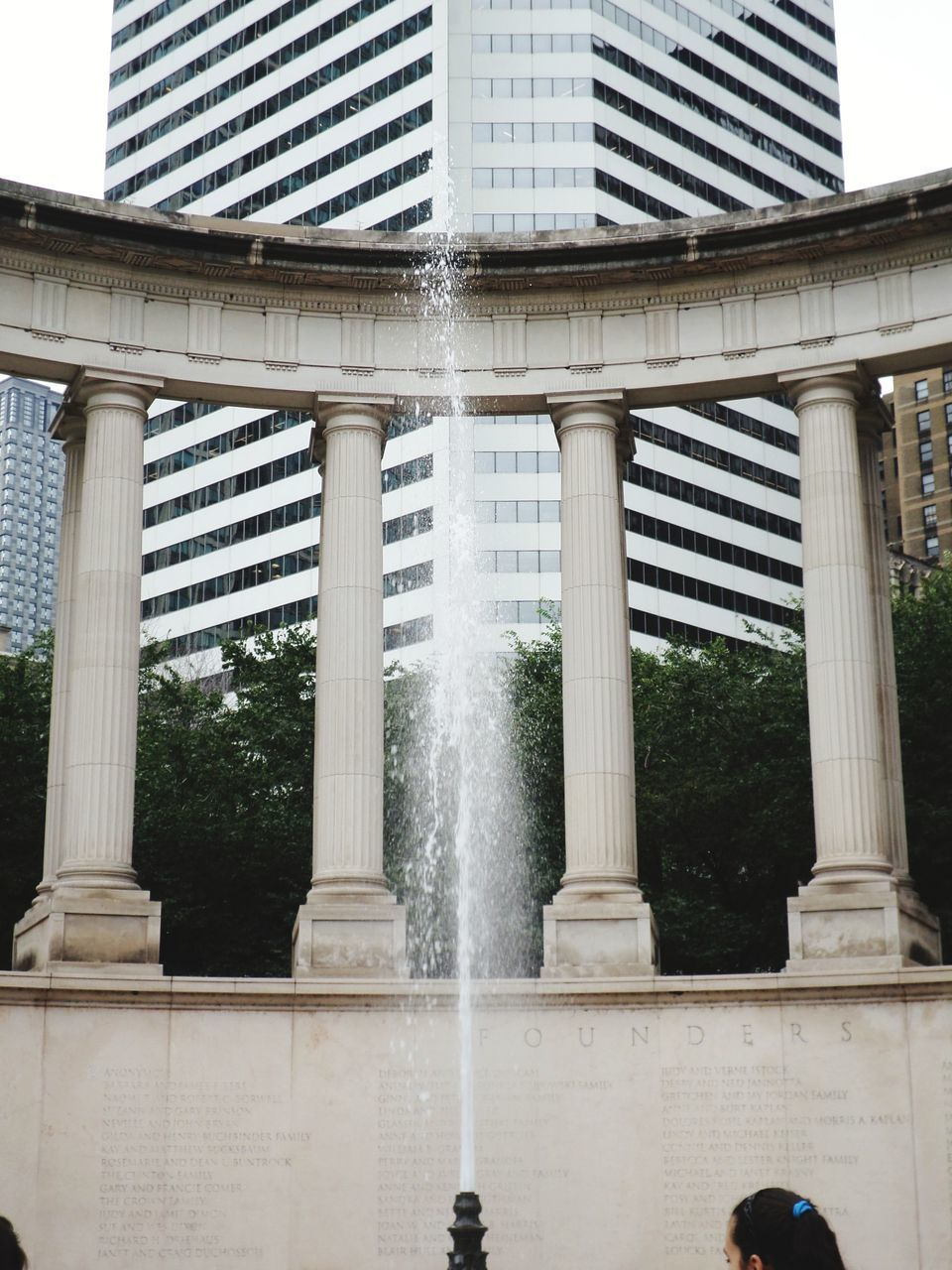 Low Angle View Of Fountain In City