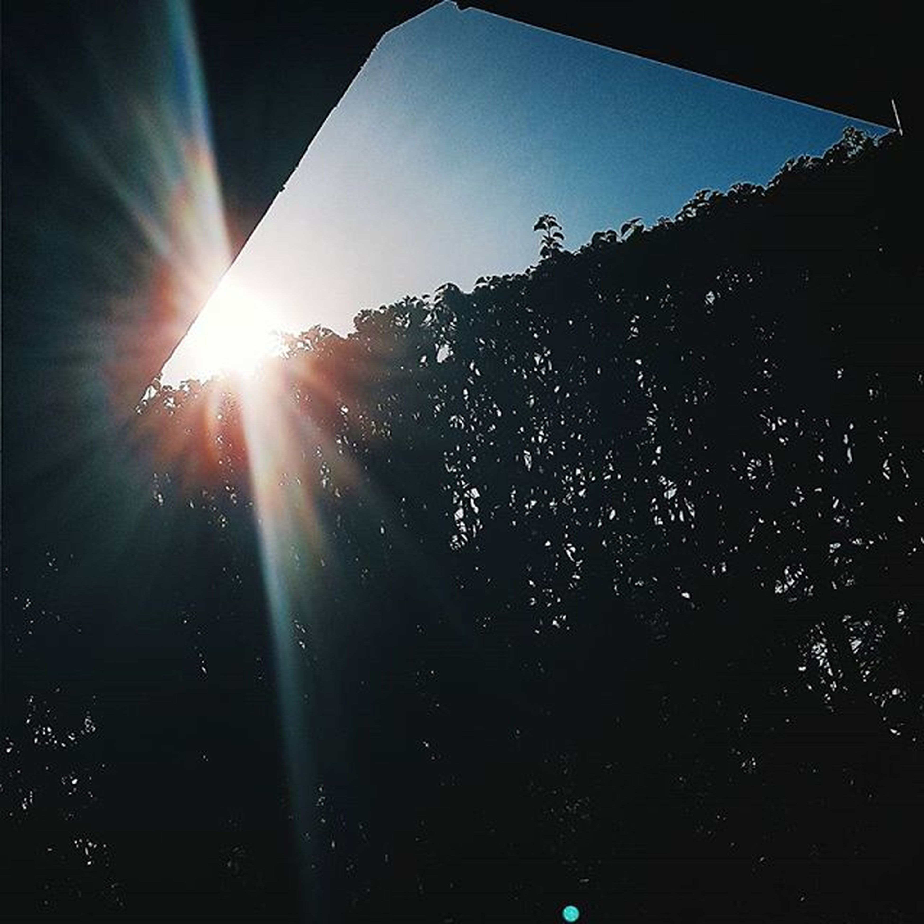 sun, sunbeam, lens flare, sunlight, bright, low angle view, sunny, clear sky, tree, sky, silhouette, nature, shining, streaming, brightly lit, back lit, beauty in nature, tranquility, built structure, shiny