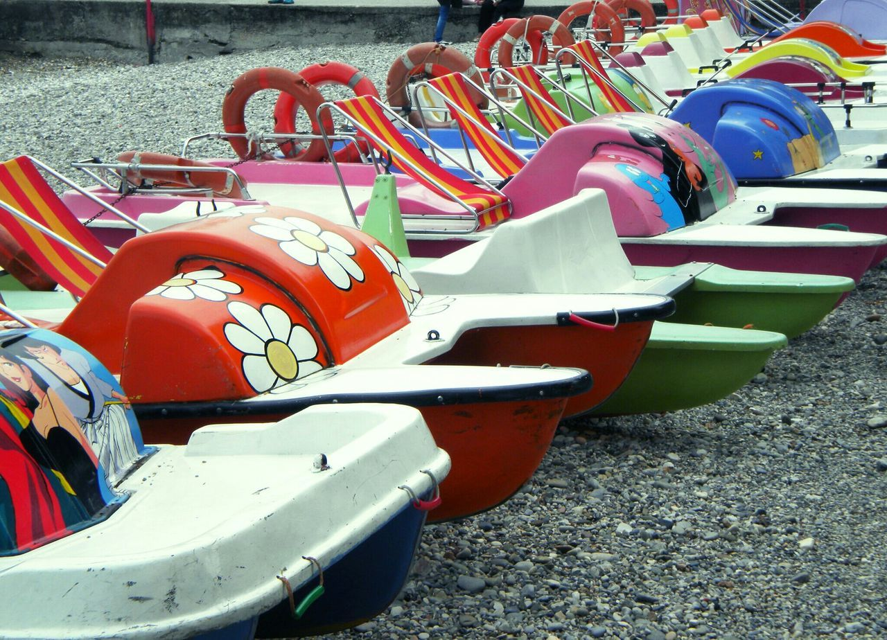 outdoors, mode of transport, day, transportation, pedal boat, no people, moored, multi colored, red