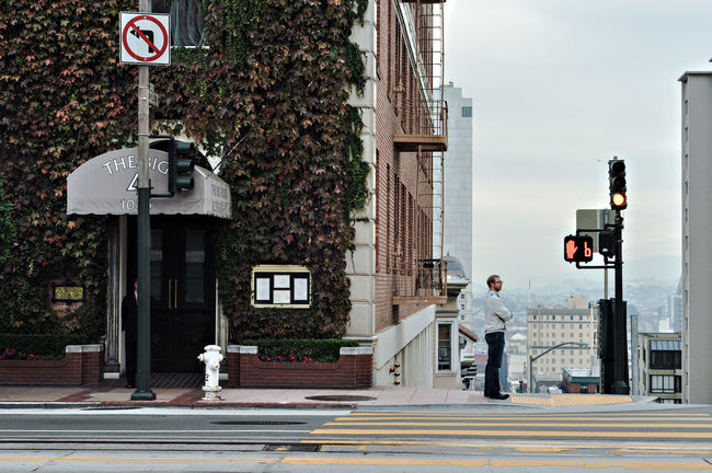 Patience Architecture Building Building Exterior Built Structure Cable Car Tracks City City Life City Street Communication Day Incidental People Nob Hill Outdoors Residential Building Road Road Sign San Francisco Sidewalk Sky Street Street Light Urban Exploration Tree Waiting Waiting ...