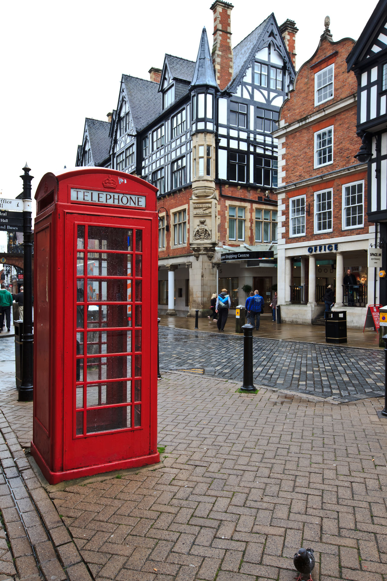 Old fashioned red telephone box in historical part of Chester, UK Adult Adults Only Architecture British Building Exterior Cheshire Chester City City Life Connection Day Eye4photography  EyeEm Gallery Historic Outdoors Pay Phone People Red Red Box Red Phone Boxes Telecommunications Equipment Telephone Telephone Booth Travel Destinations Uk