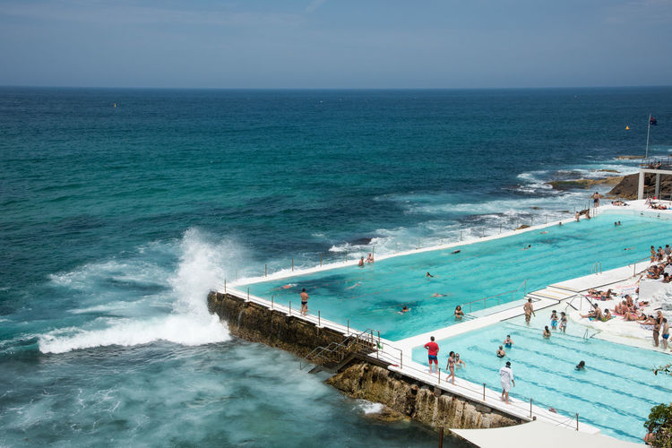 SYDNEY,NSW,AUSTRALIA-NOVEMBER 21,2016: Bondi Beach with Bondi Icebergs Pool and tourists in Sydney, Australia Australia Bondi Beach Icebergs Relaxing Swimming Tourists Water's Edge Wave Bondi Icebergs Club Crashing Enjoying Life Leisure Activity Lifestyles Ocean Pacific Ocean Pool Power In Nature Real People Sea Sydney Vacation Water Waterfront Waves