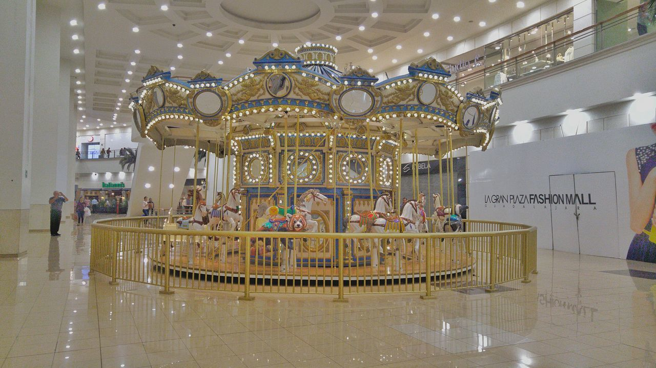 amusement park, arts culture and entertainment, carousel, amusement park ride, indoors, chair, built structure, no people, architecture, merry-go-round, day