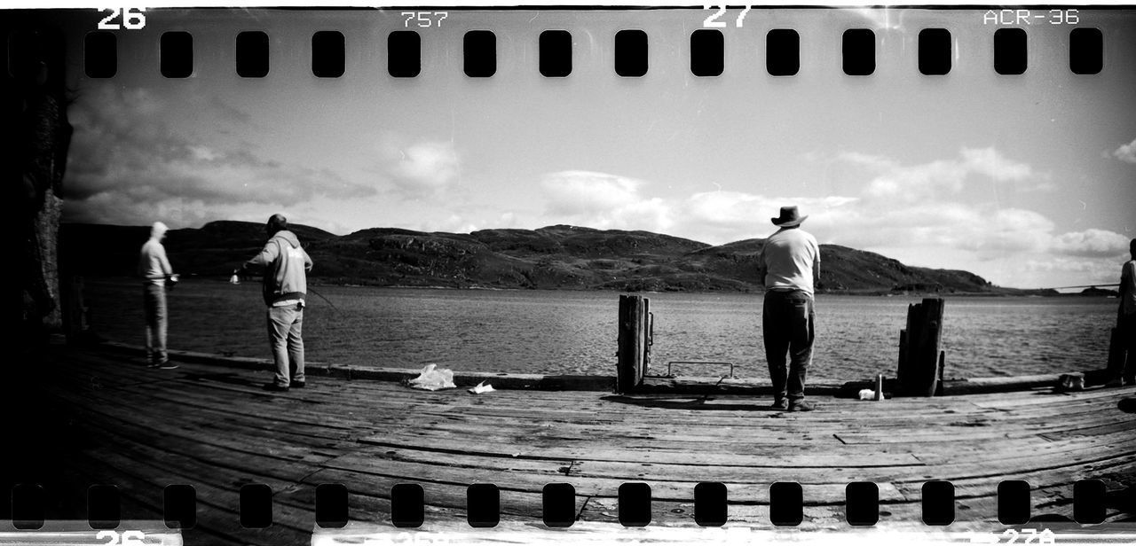 35mm Film Blackandwhite Blackandwhite Photography Day Film Film Photography Filmisnotdead Fishing Pole Nature No People Outdoors Real People Sea Sky Sprocket Rocket Panorama Standing Unrecognizable Person