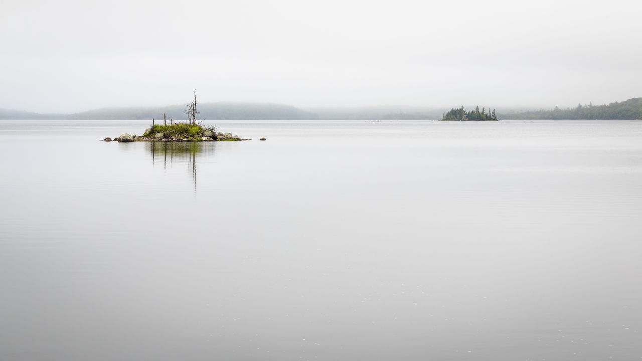 Somewhere along the East Shore of Nova Scotia-- a calm and misty morning Atlantic Ocean Beauty In Nature Clean Day East Shore Fog Island Lowkey  Minimalism Mist Muted Colors Nature No People Nova Scotia Outdoors Scenics Sky Subdued Tranquil Scene Tranquility Water