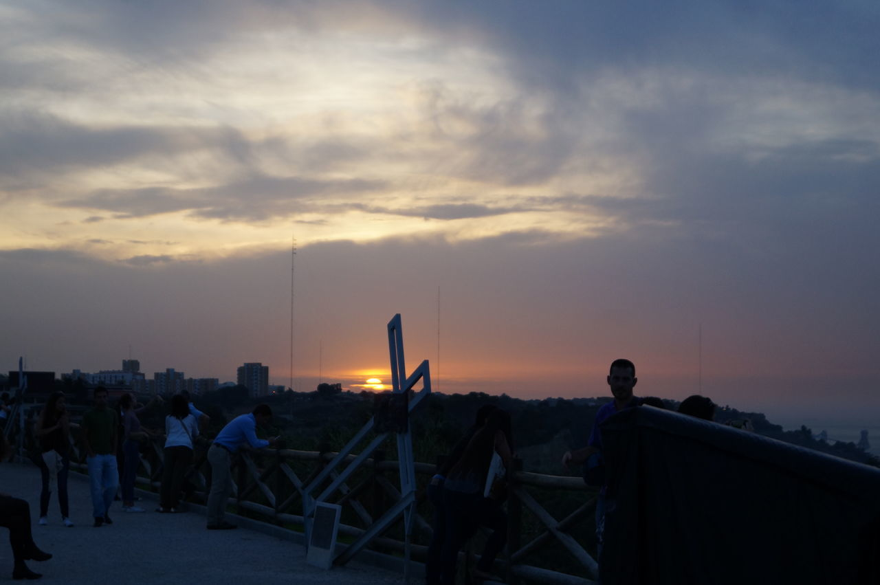 sunset, sky, cloud - sky, nature, built structure, outdoors, real people, architecture, men, scenics, beauty in nature, building exterior, day, people