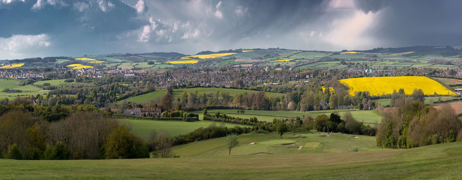 View over Dorchester in Dorset. Beauty In Nature Cloud - Sky Day Field Grass Green Color Landscape Nature No People Outdoors Rural Scene Scenics Sky Tranquil Scene Tranquility Tree Yellow