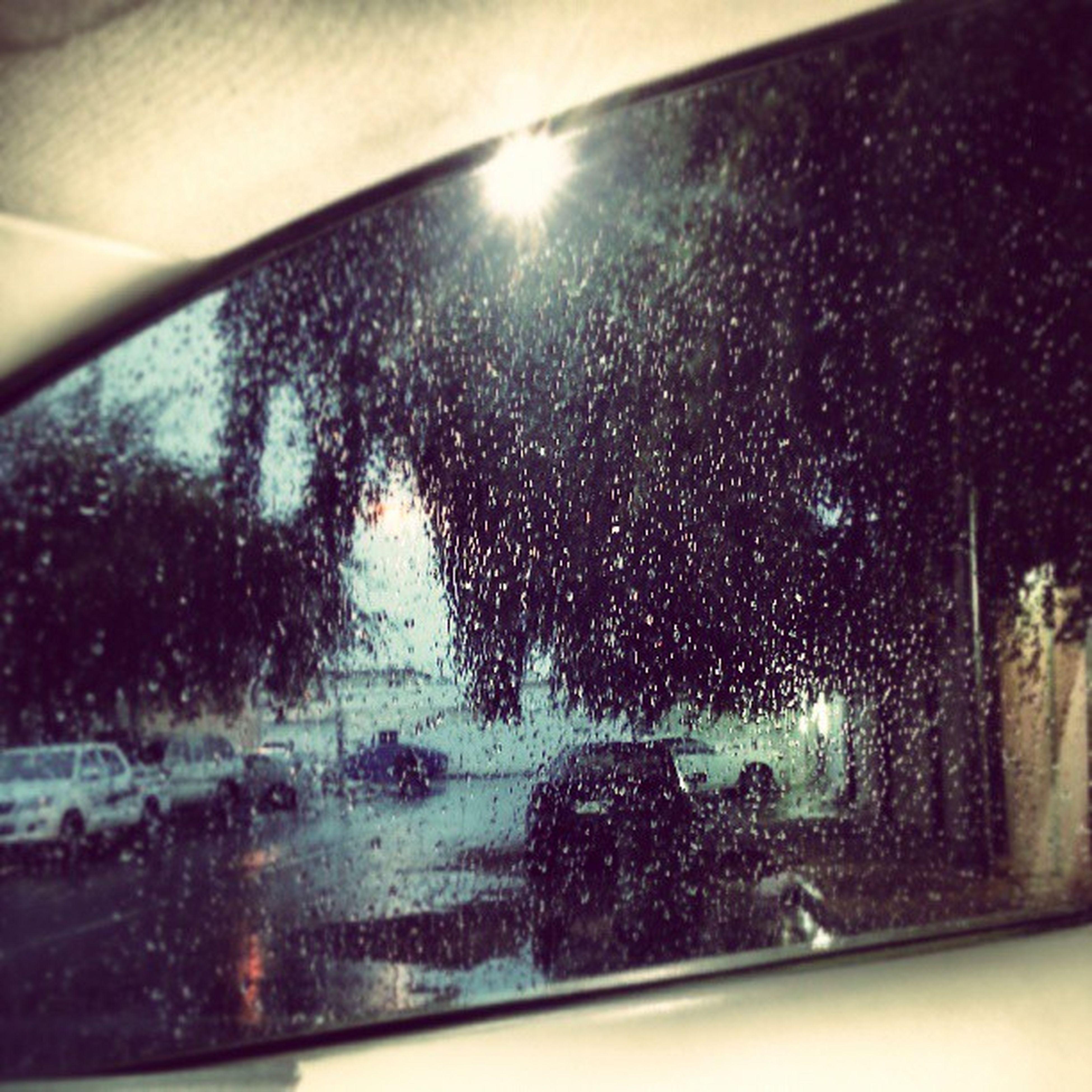 wet, drop, season, window, glass - material, rain, water, transportation, transparent, indoors, car, vehicle interior, raindrop, weather, road, land vehicle, windshield, street, mode of transport, close-up