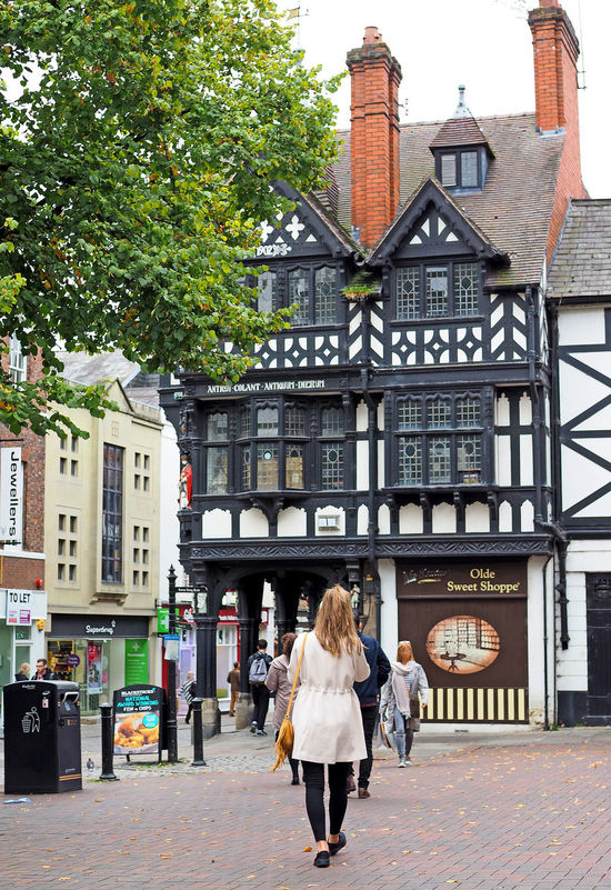 A Taste Of Chester, UK Elizabethan Architecture Glorious Chester Olde Sweet Shoppe Adult Architecture Backpack Building Exterior Built Structure Casual Clothing City City Life Day Full Length Leisure Activity Lifestyles Men One Person Outdoors People Real People Rear View Walking Women