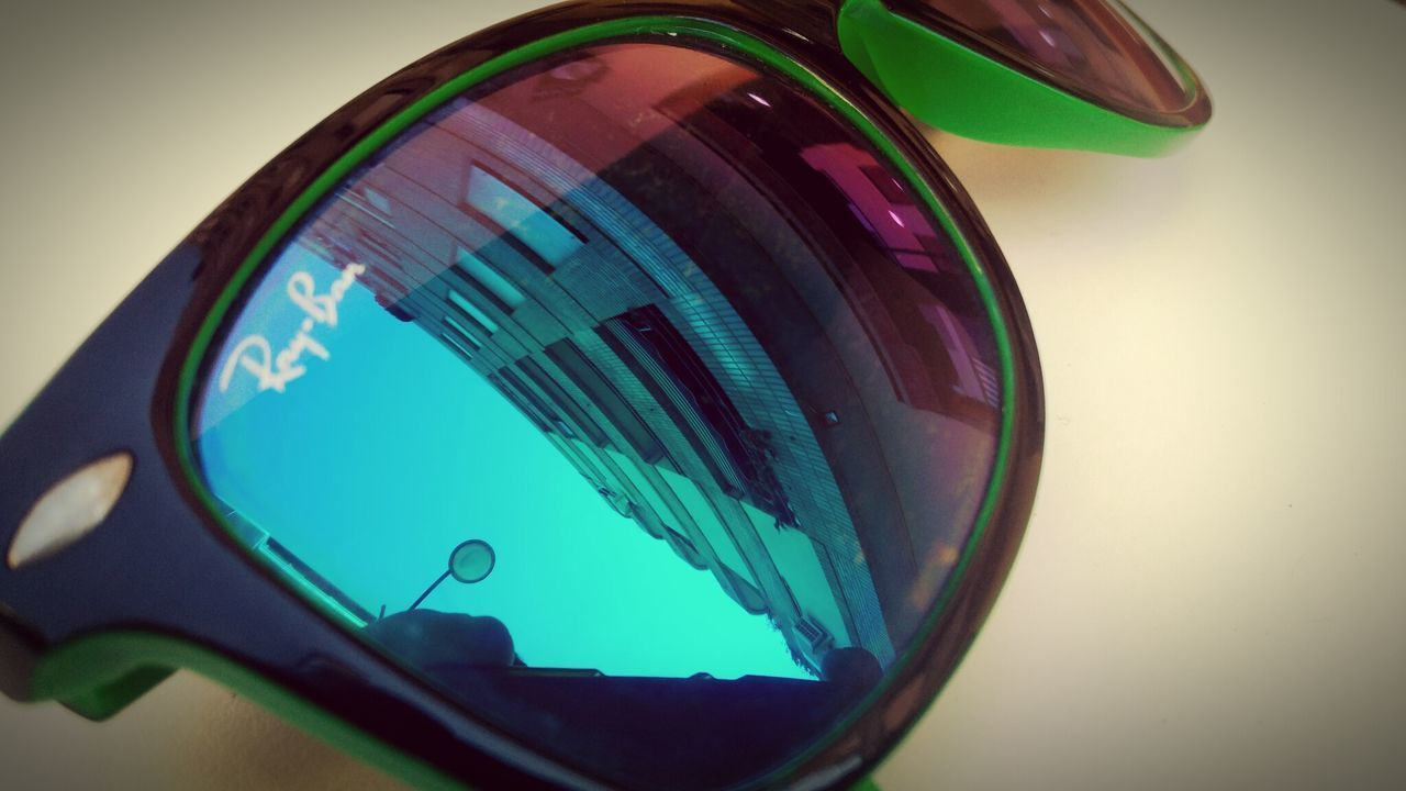 Blue Reflection Close-up No People Water Outdoors Sky Day Sunglasses Green Edificio Vintage Building