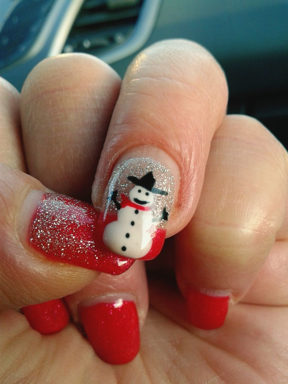Cropped Hand Showing Snowman Nail Art